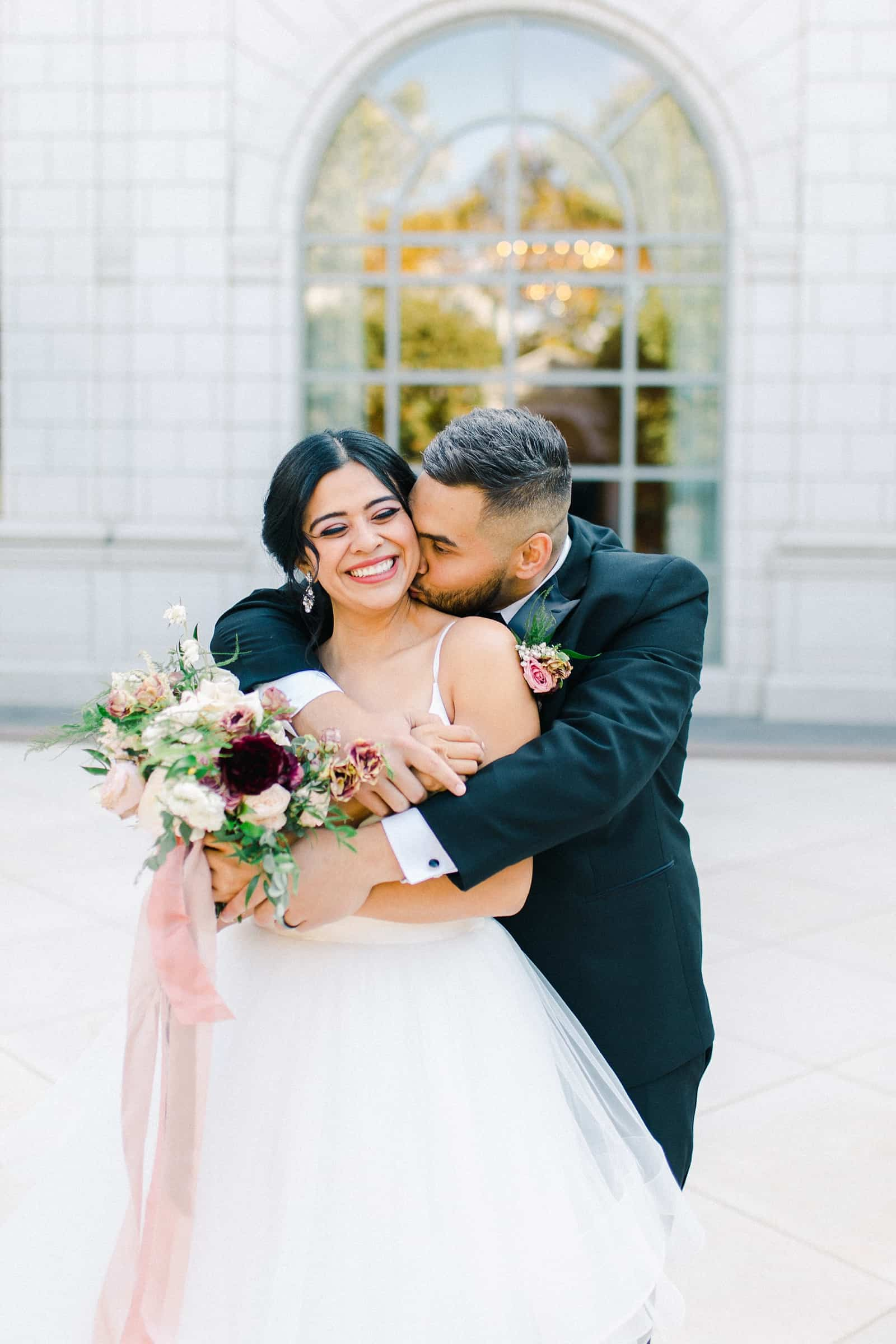 Bride and groom share a sweet moment together on their wedding day