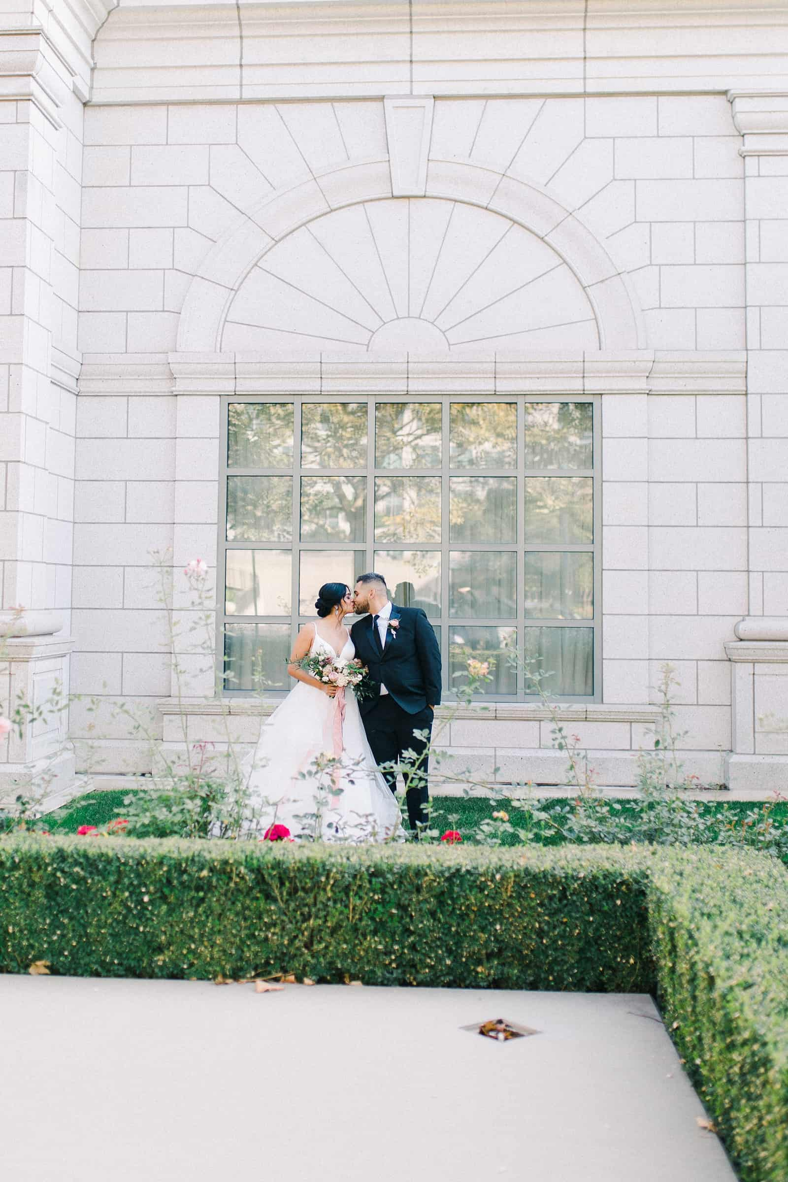 Grand America Hotel wedding, bride and groom in garden with roses, summer wedding
