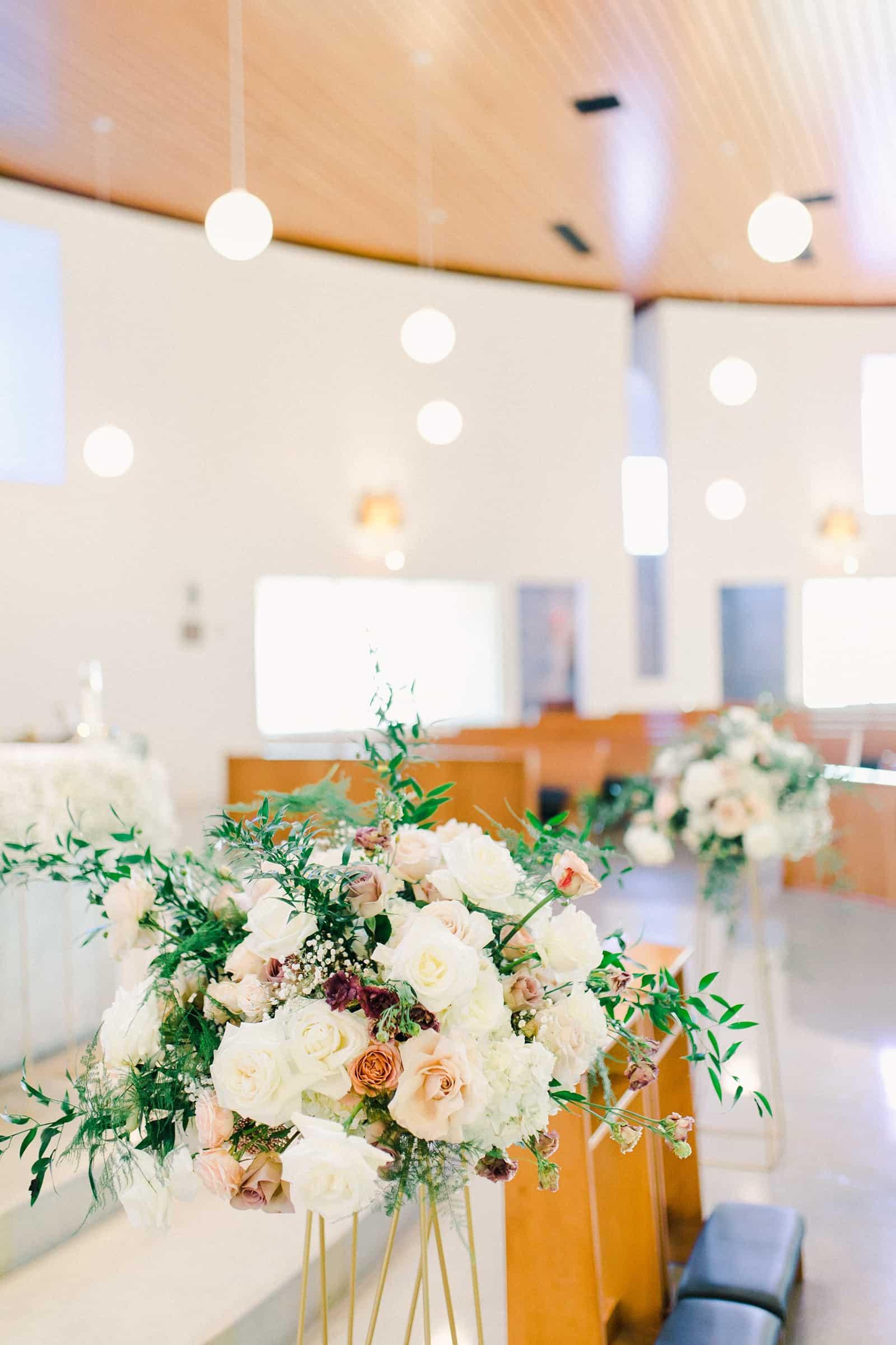 Church wedding with rose centerpieces arrangements