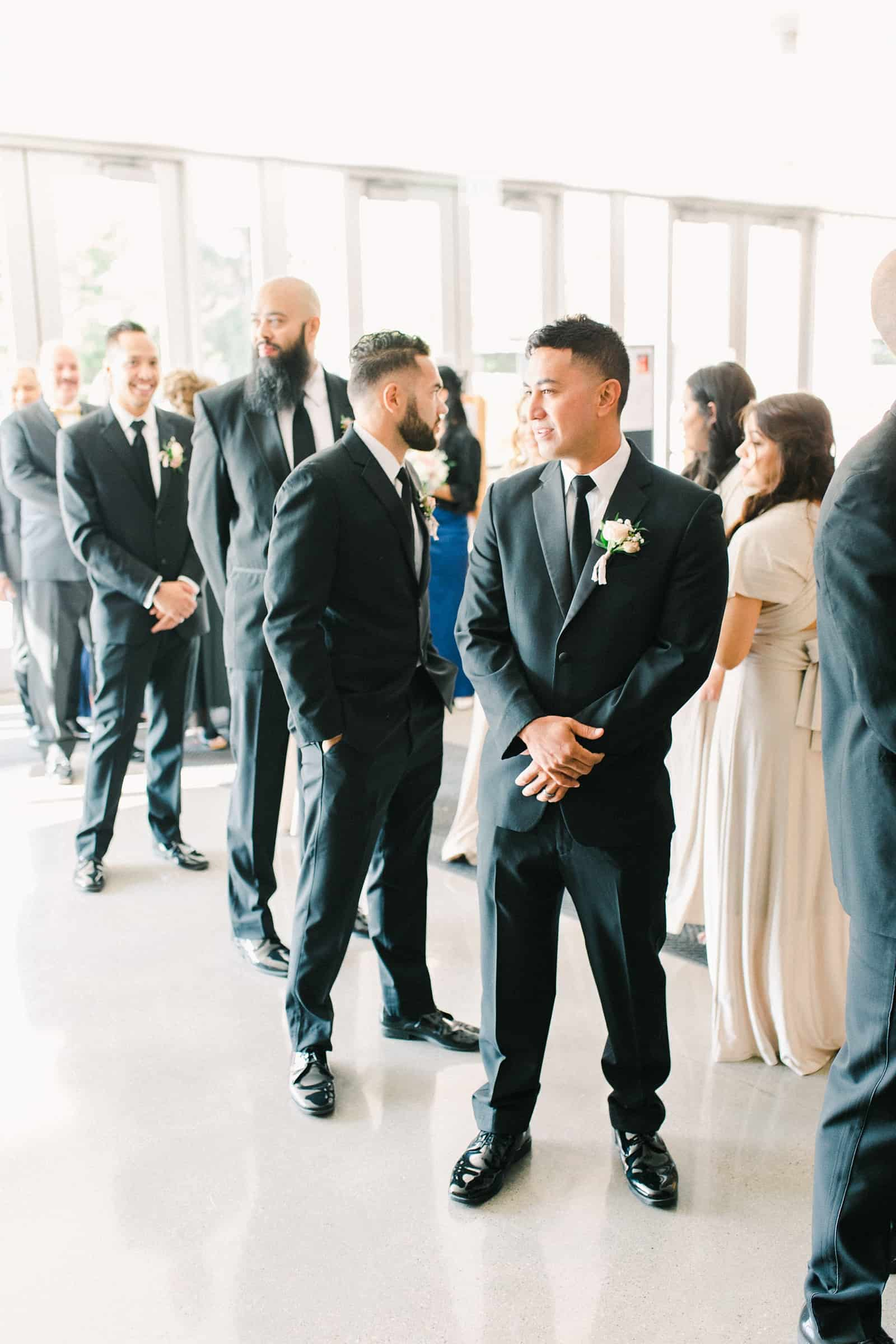 Groom and groomsmen get ready for the ceremony