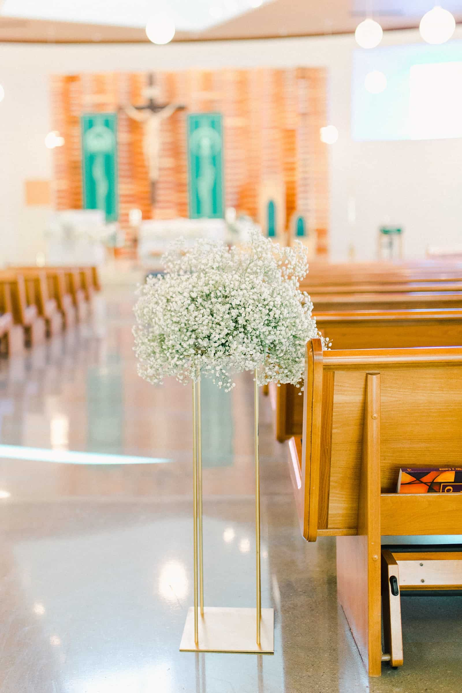 Baby's breath arrangement during cathedral wedding ceremony