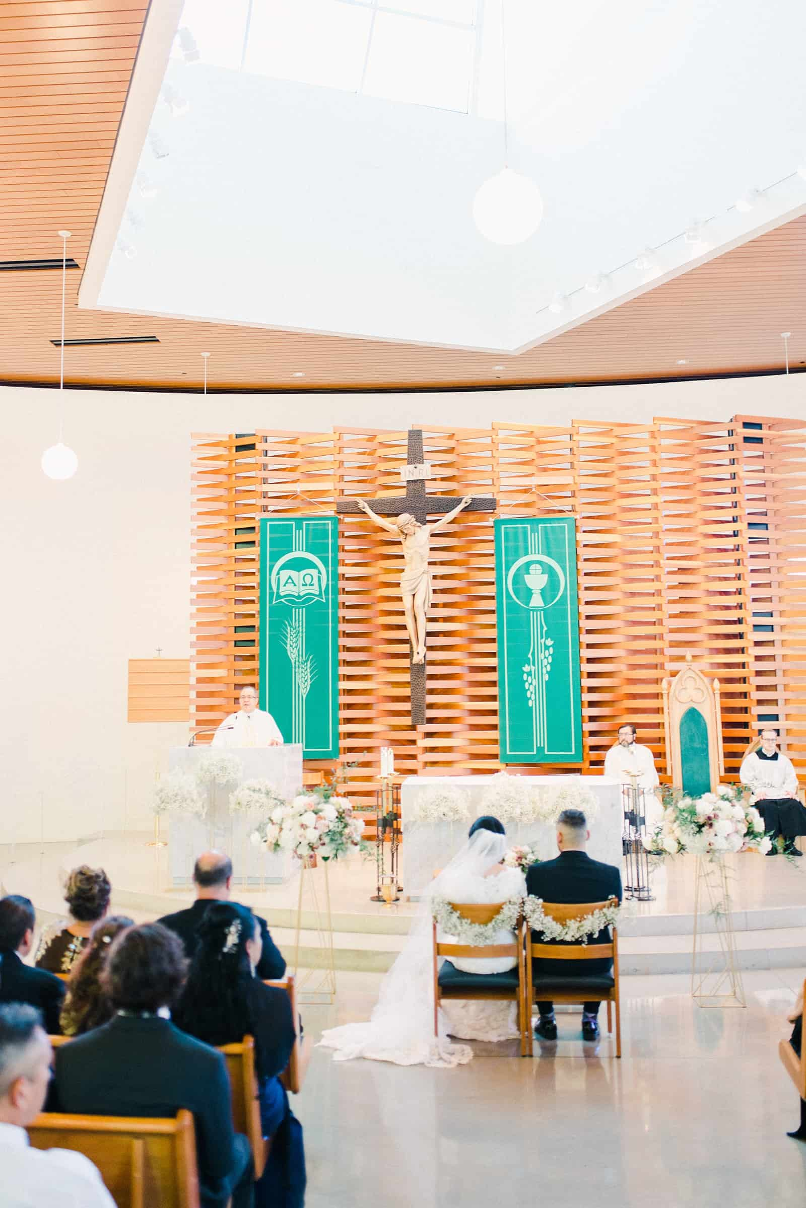 Chapel cathedral ceremony in Utah, bride and groom sitting