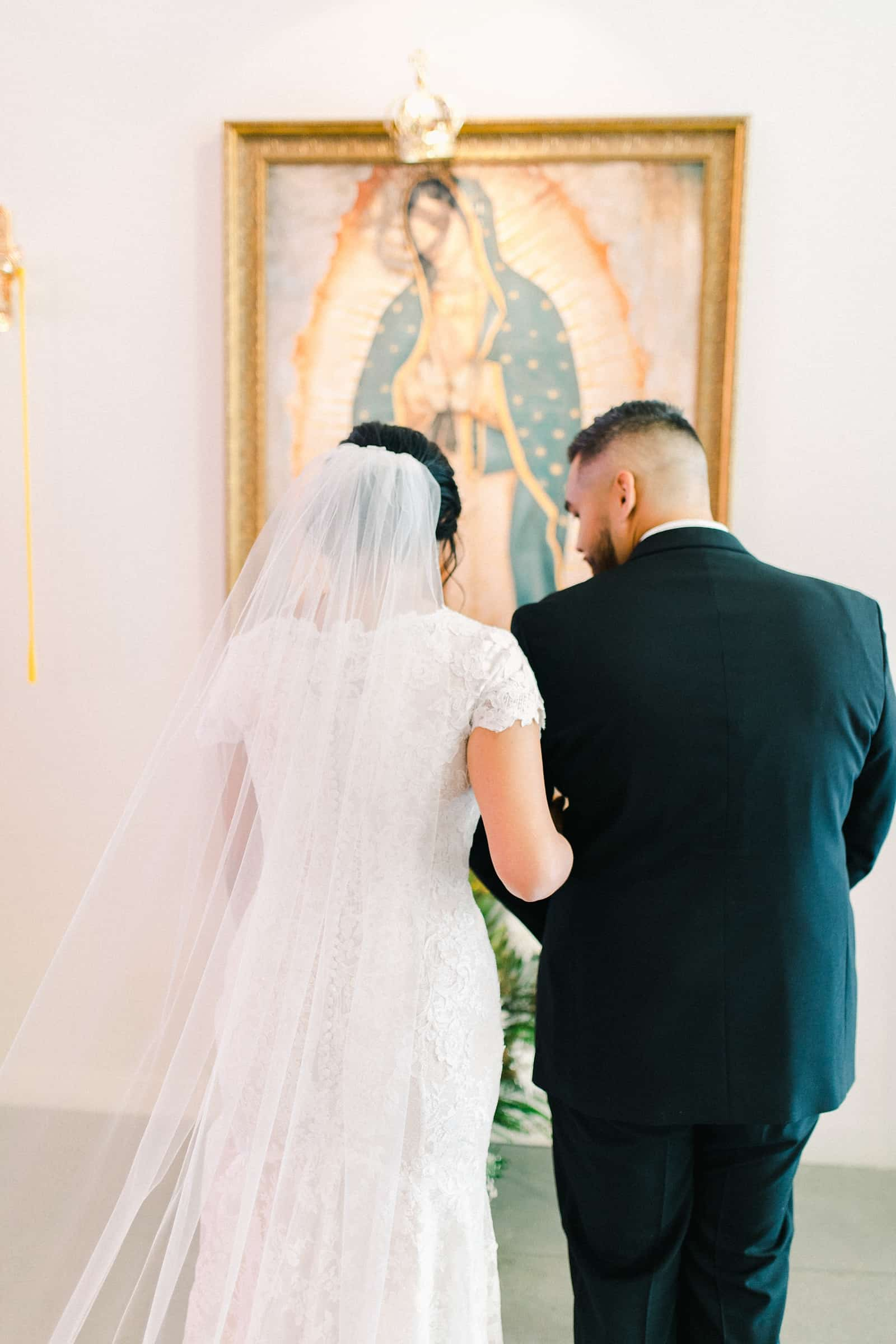 Bride and groom walk out of church together after wedding ceremony