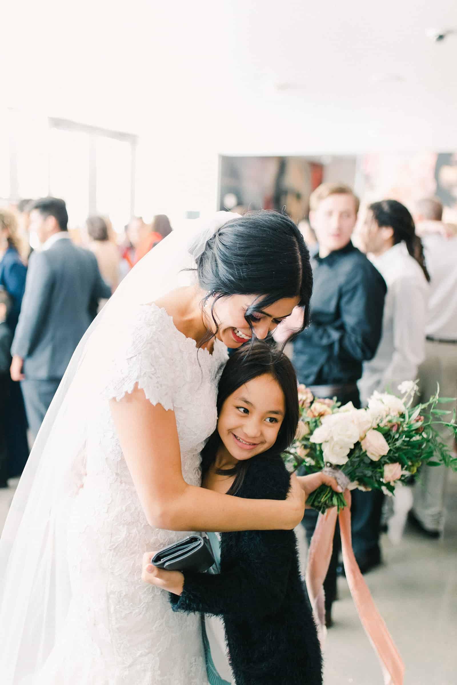 Bride hugs guest after wedding ceremony