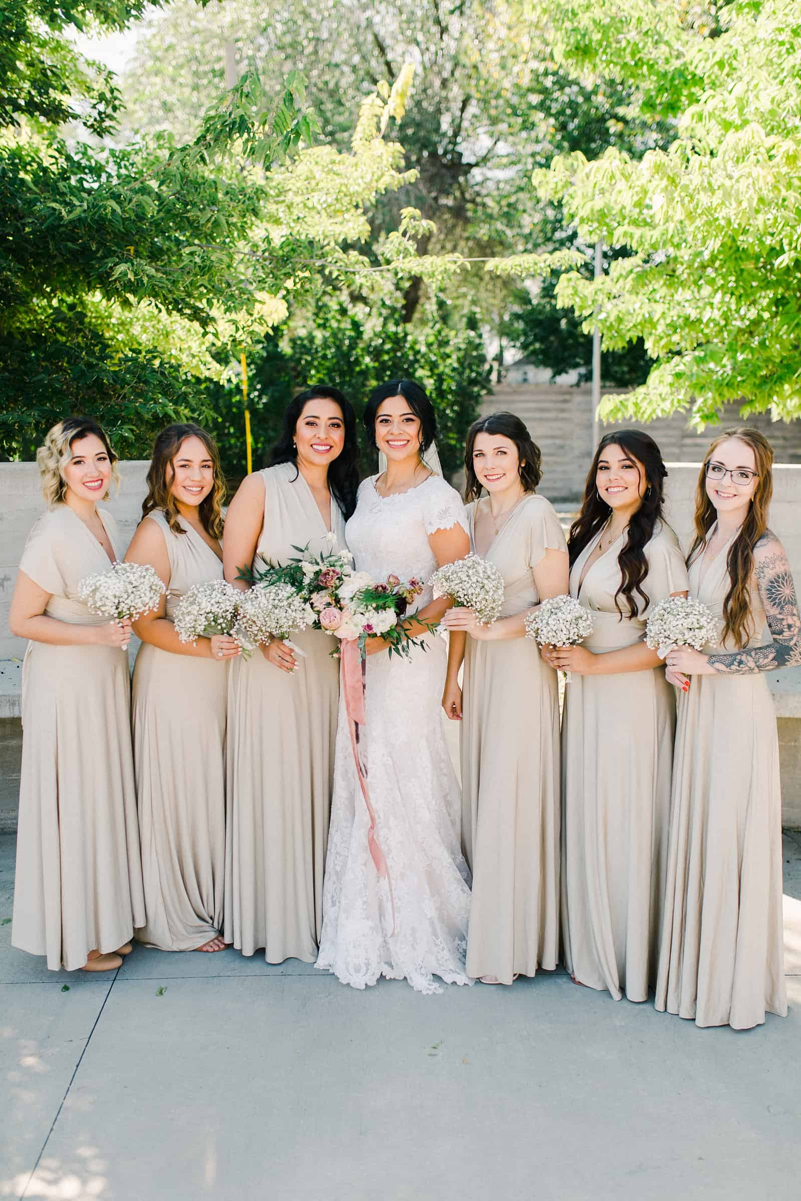 bride and bridesmaids wearing gold champagne long maxi bridesmaids dresses with bouquets