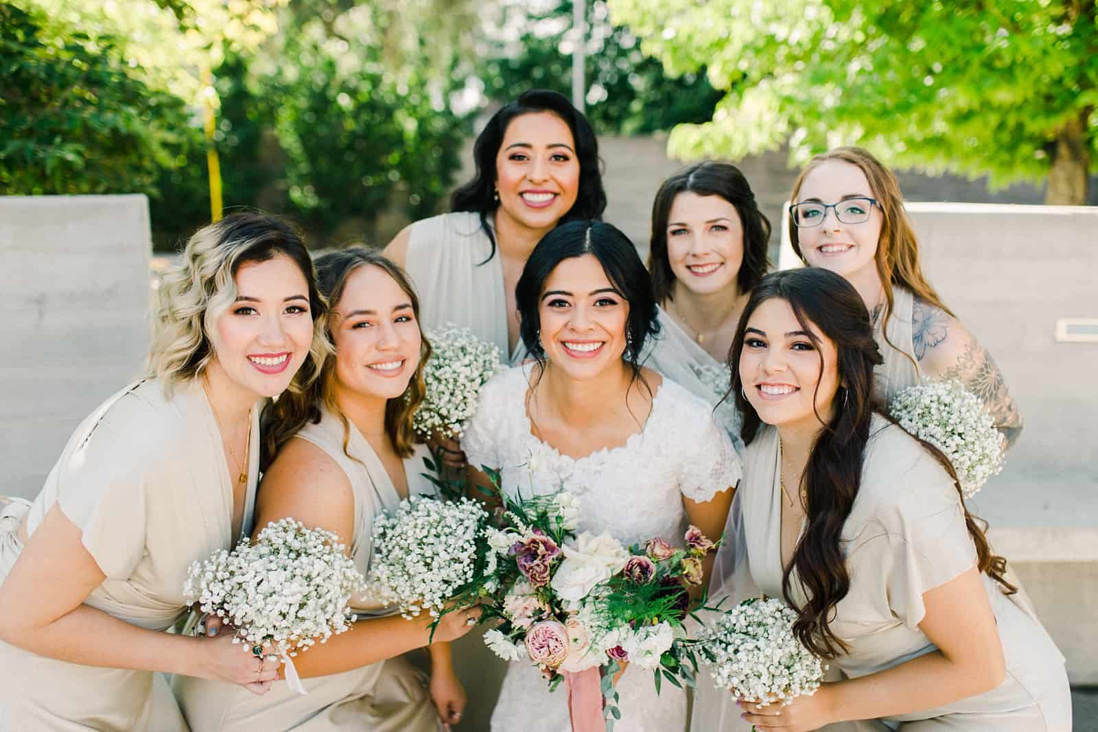 bride and bridesmaids wearing gold champagne long maxi bridesmaids dresses with baby's breath bouquets