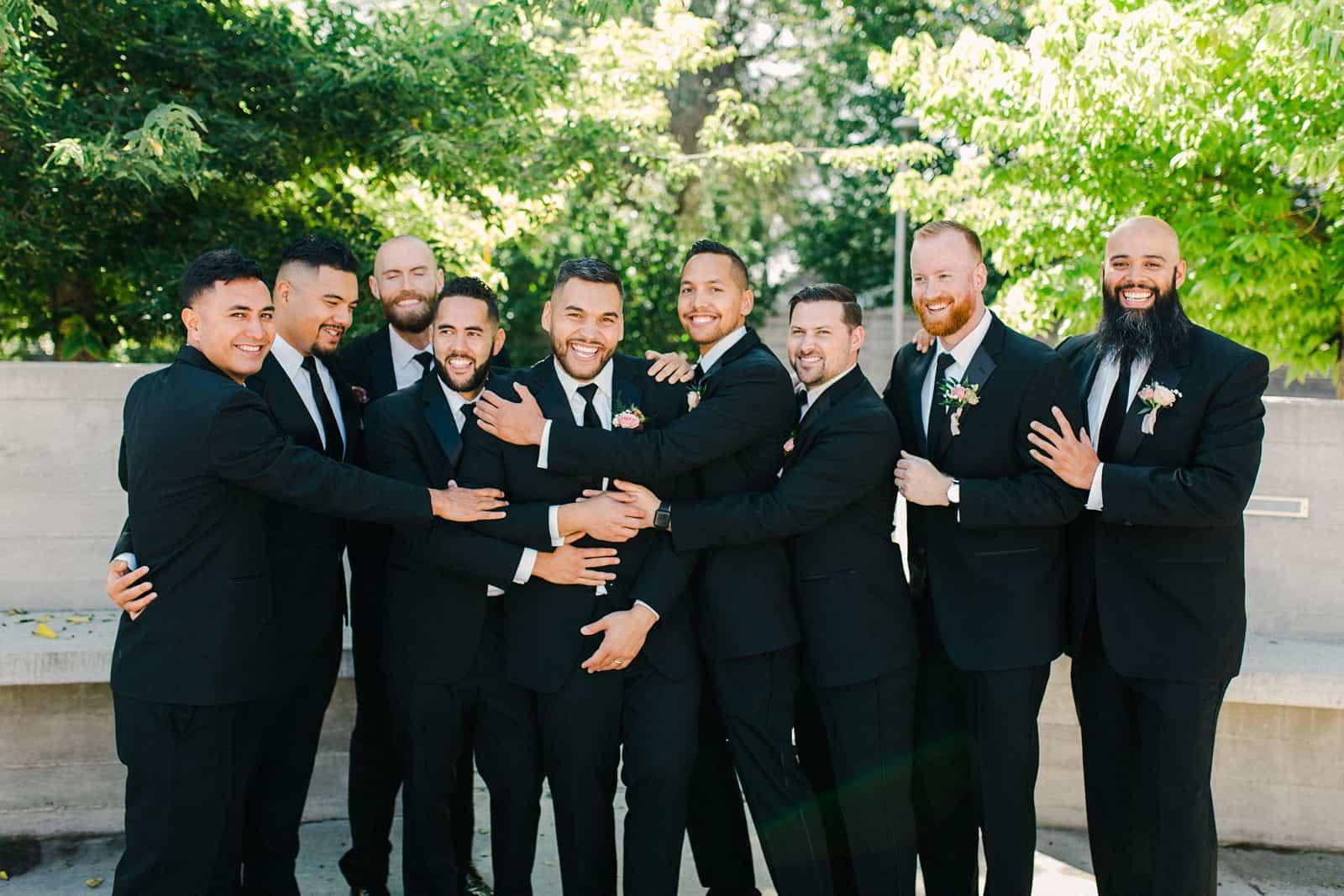 Groom and groomsmen in classic black tuxedos