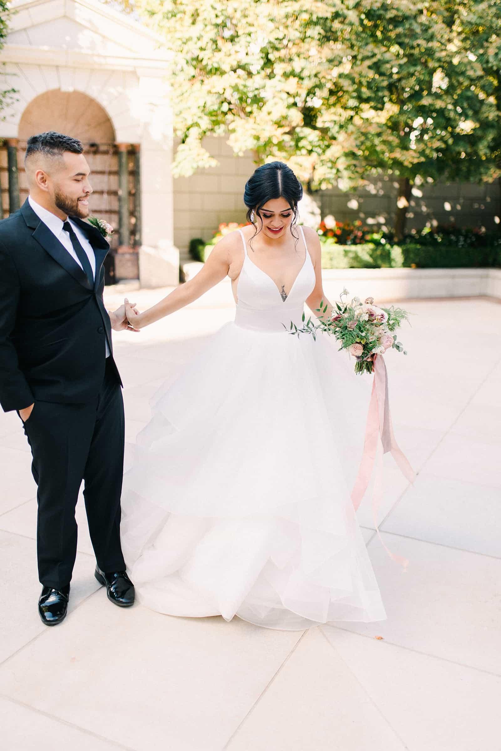 Bride wearing v neck and tulle wedding dress