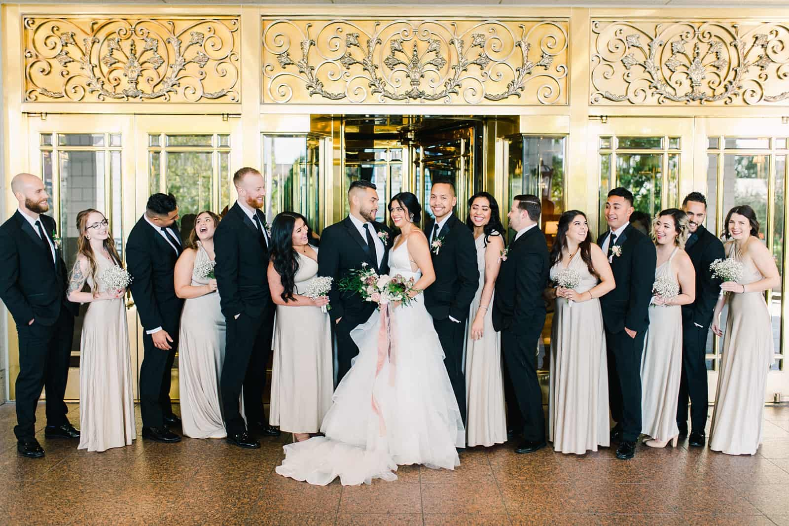 Bridal party with bride and groom outside the Grand America Hotel