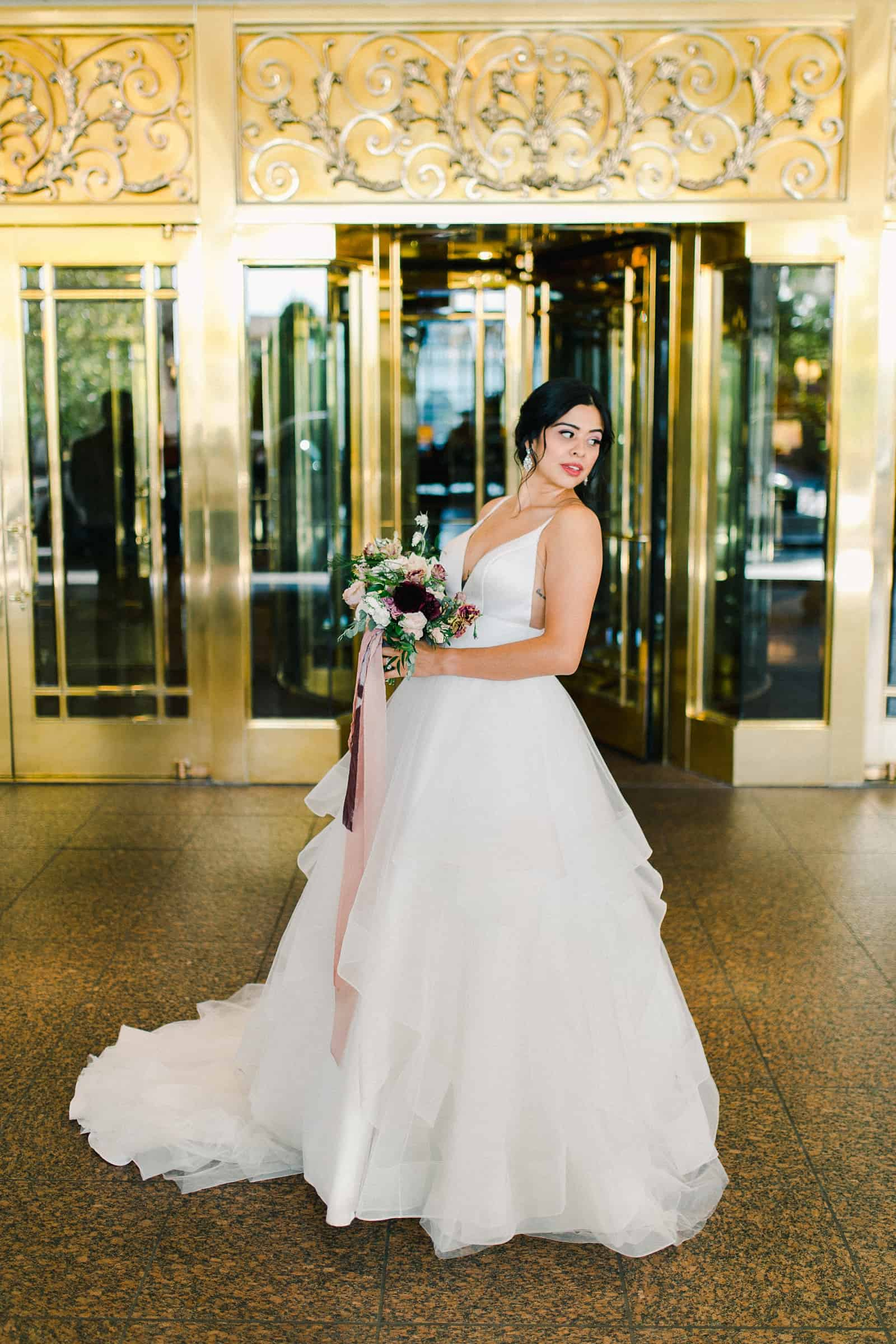 Bride with tulle skirt and long train outside the Grand America Hotel