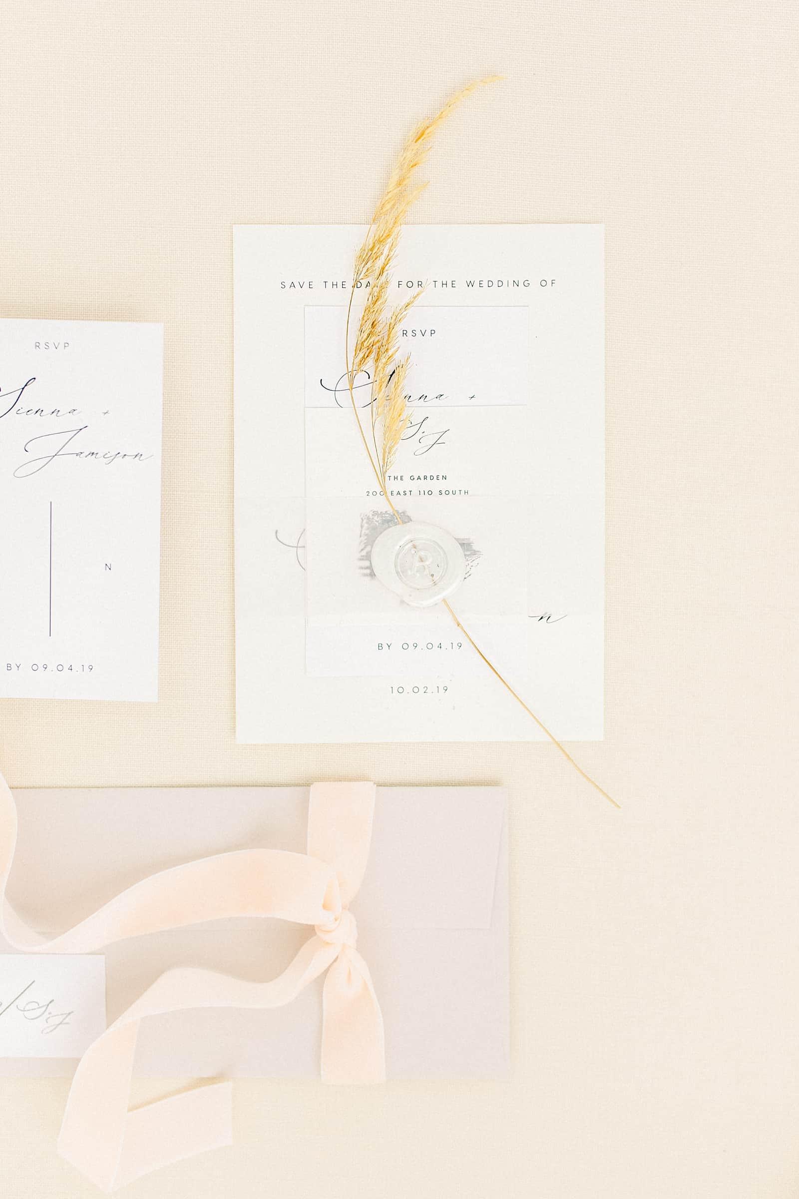 Modern minimalist wedding invitations with white wax seal