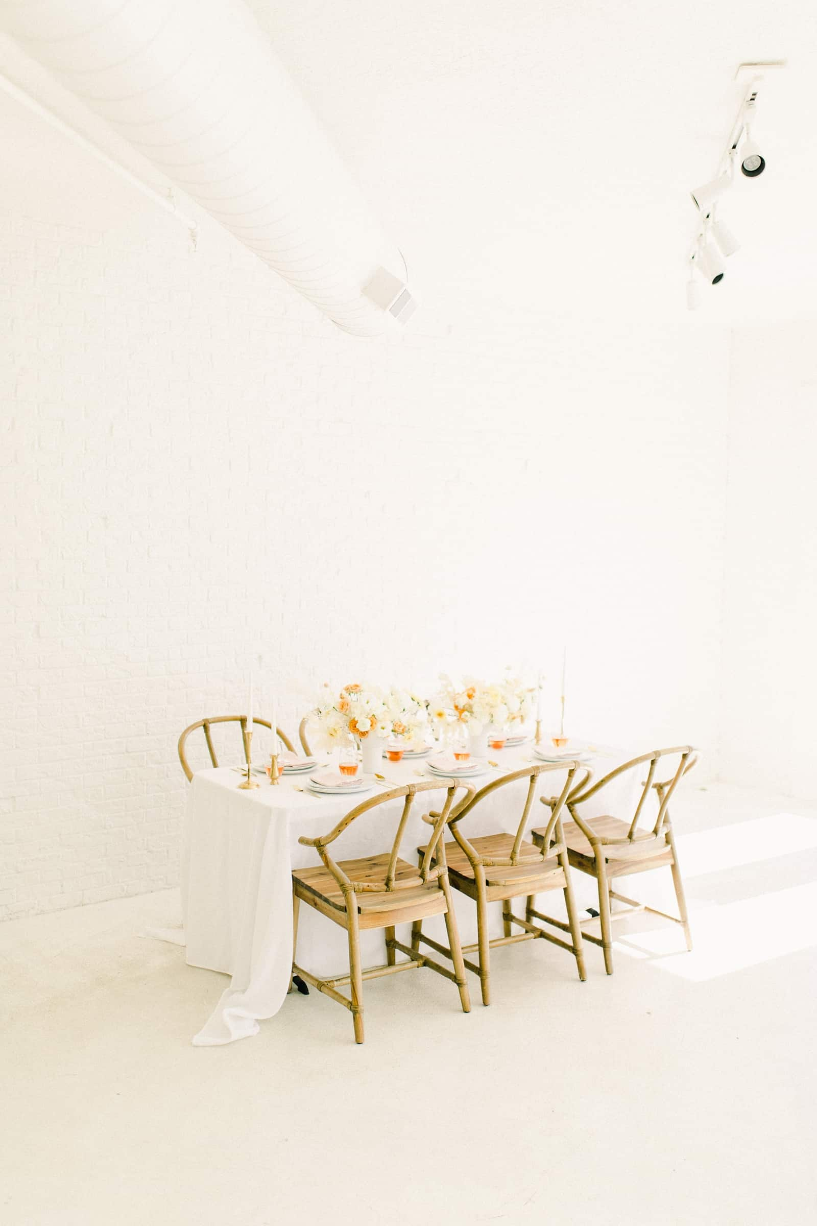 Modern wedding table settings with white tablecloth and neutral colors