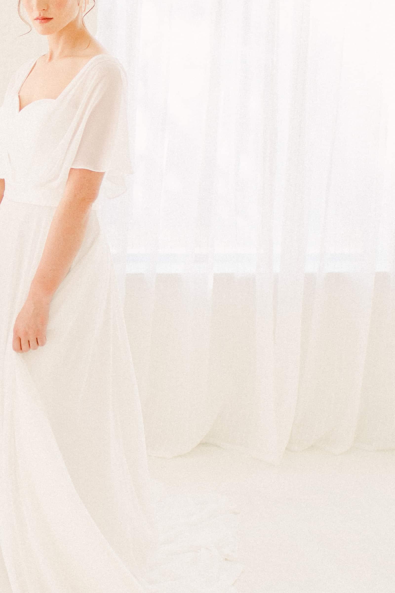 Simple modern chiffon flowy wedding dress with sweetheart neckline