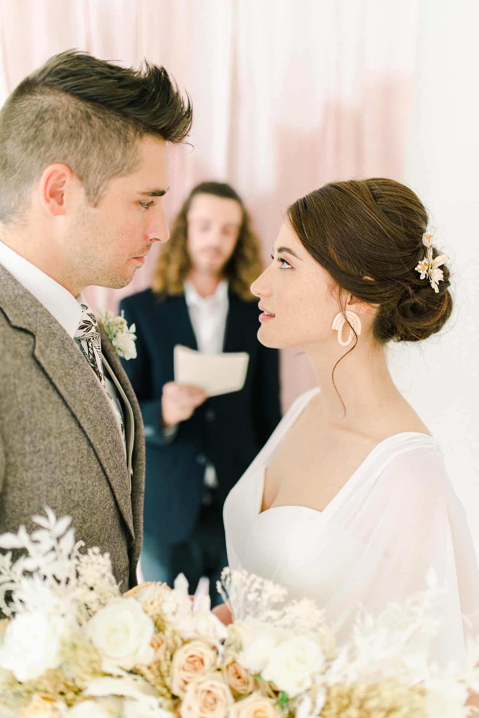 Modern wedding ceremony with blush pink painted backdrop