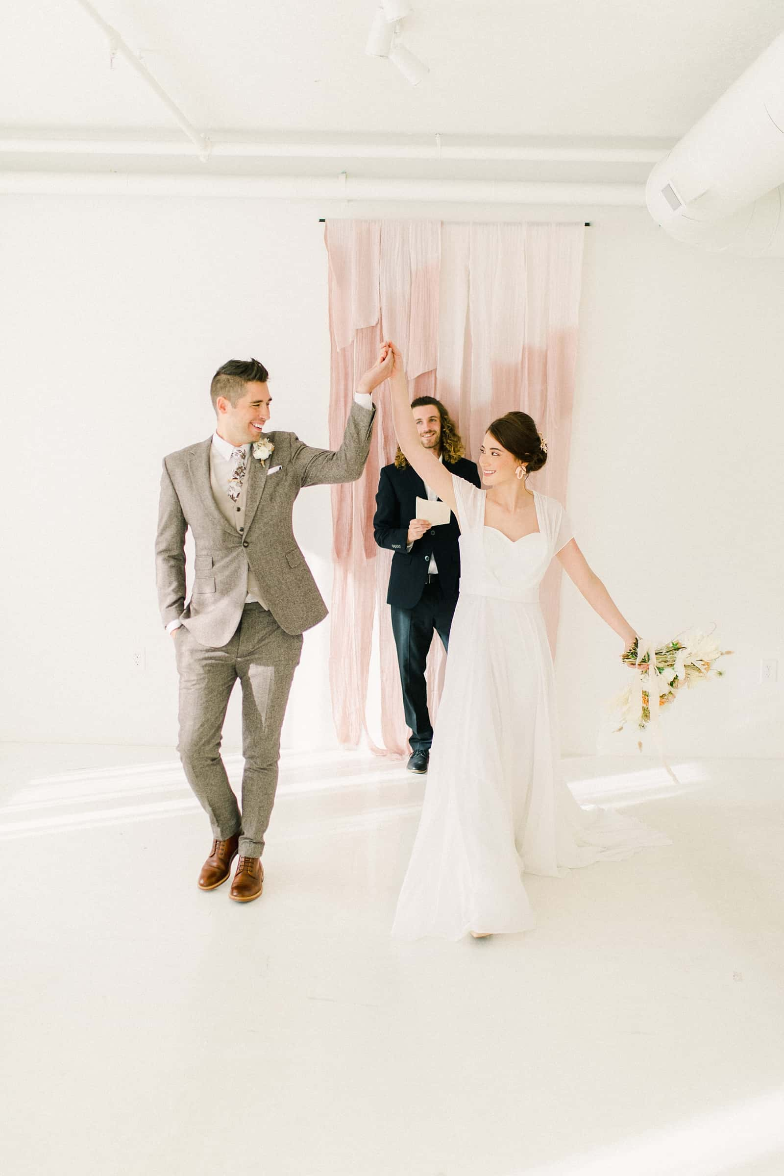 Bride and groom cheer after wedding ceremony
