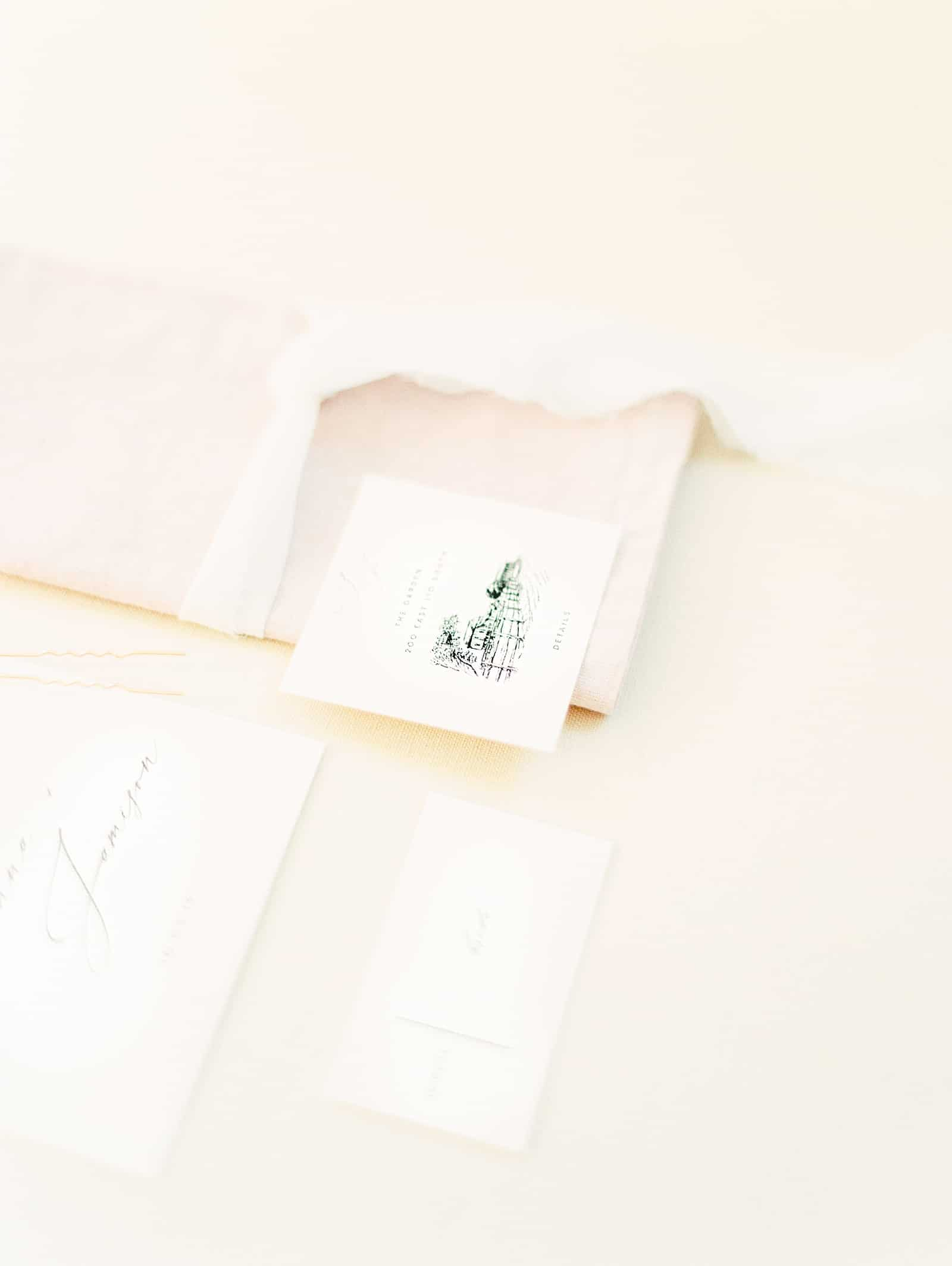 Modern minimalist wedding invitations with calligraphy, back and white venue sketch