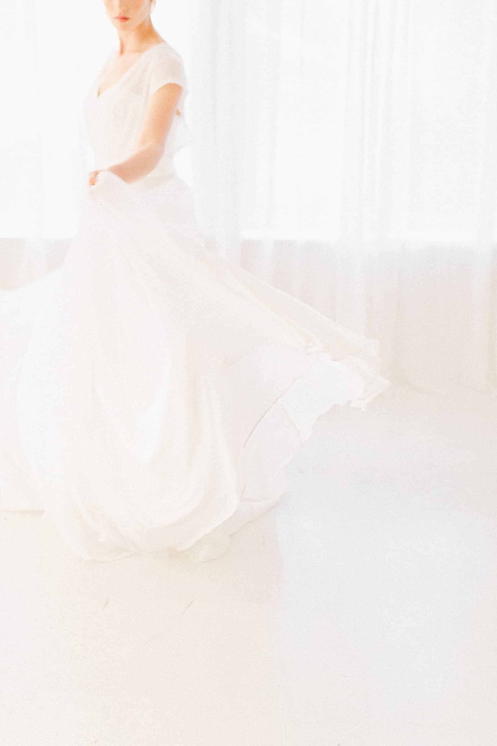 Bride twirls in flowy white wedding dress