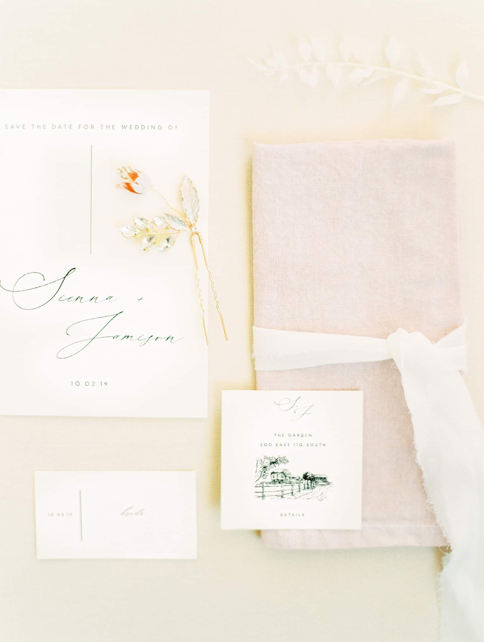 Modern minimalist wedding invitations with calligraphy and venue sketch