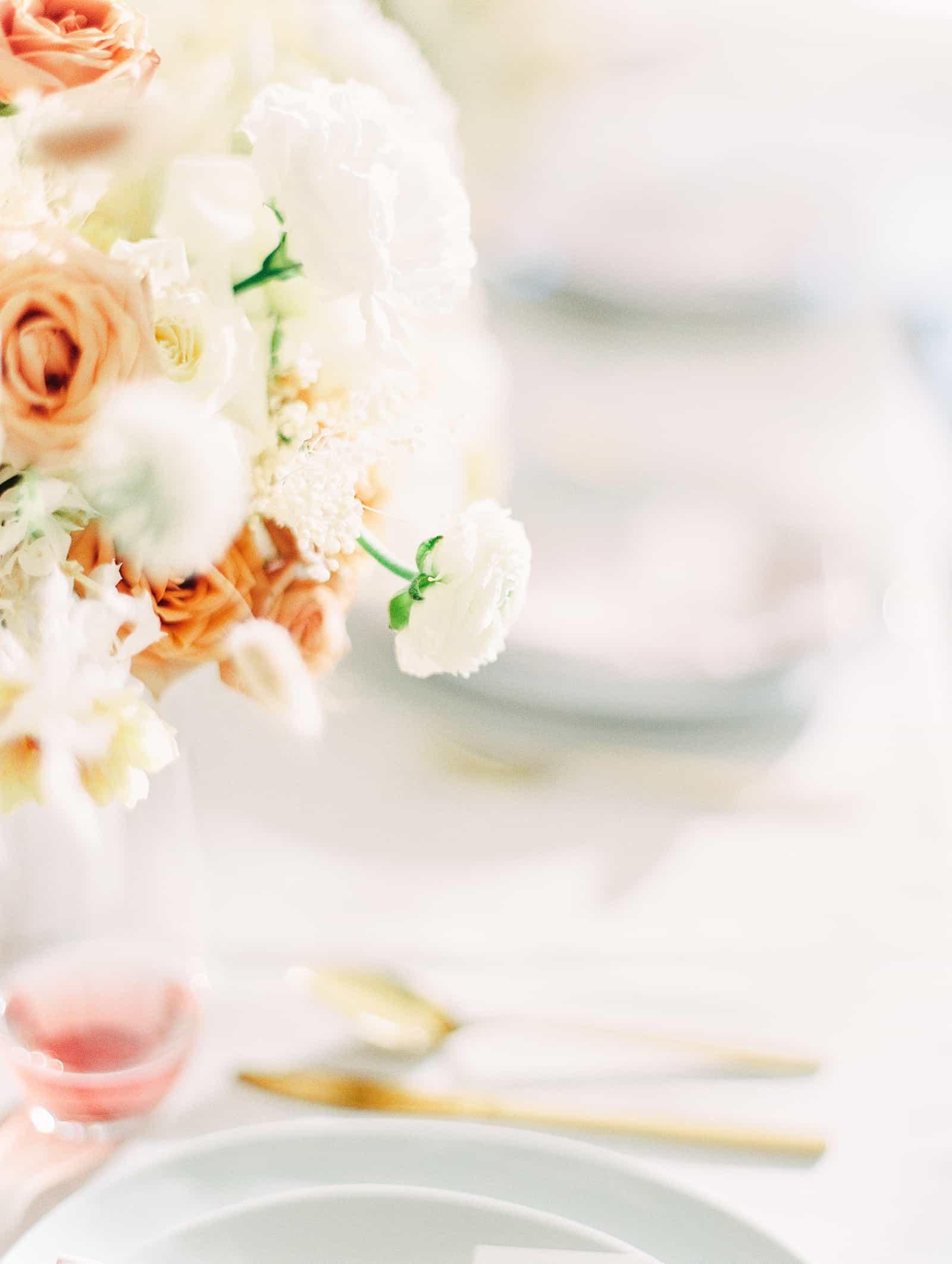 Modern wedding table with white and orange flower centerpiece
