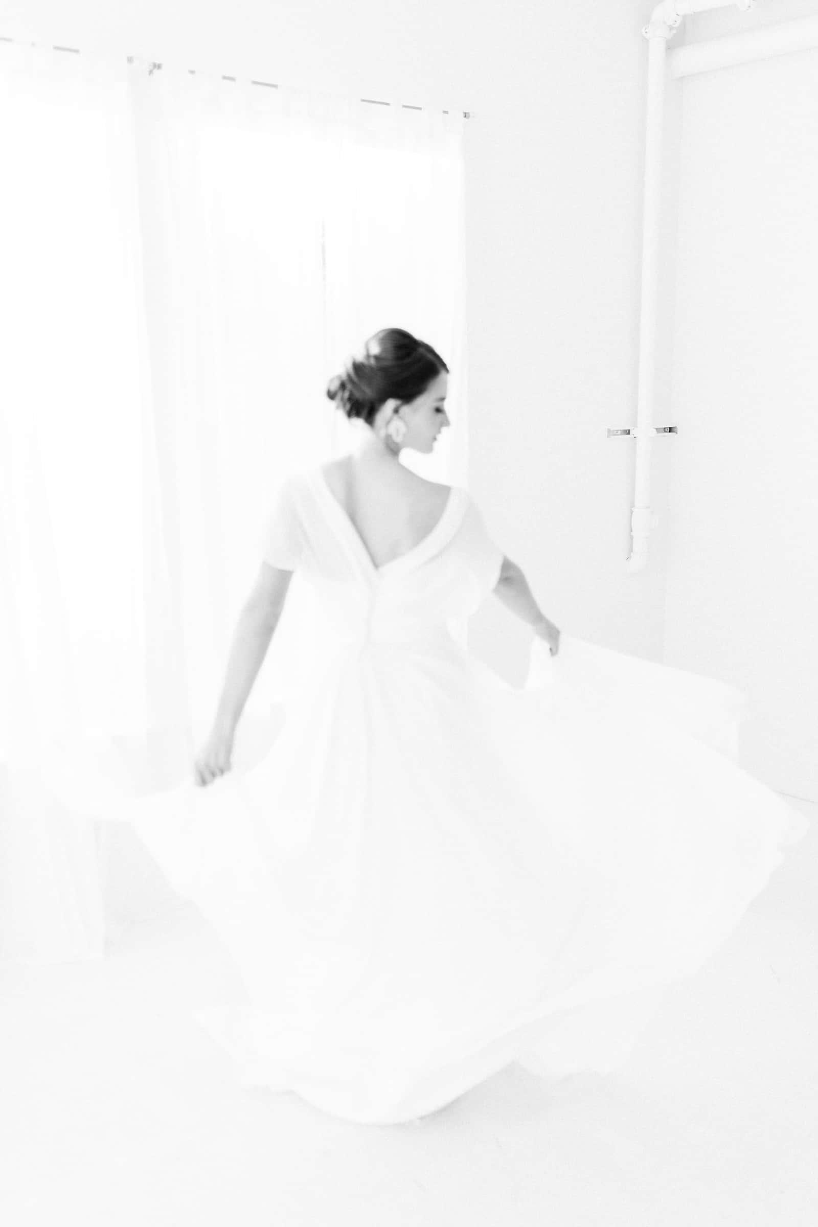 Modern bride twirls, black and white film photography