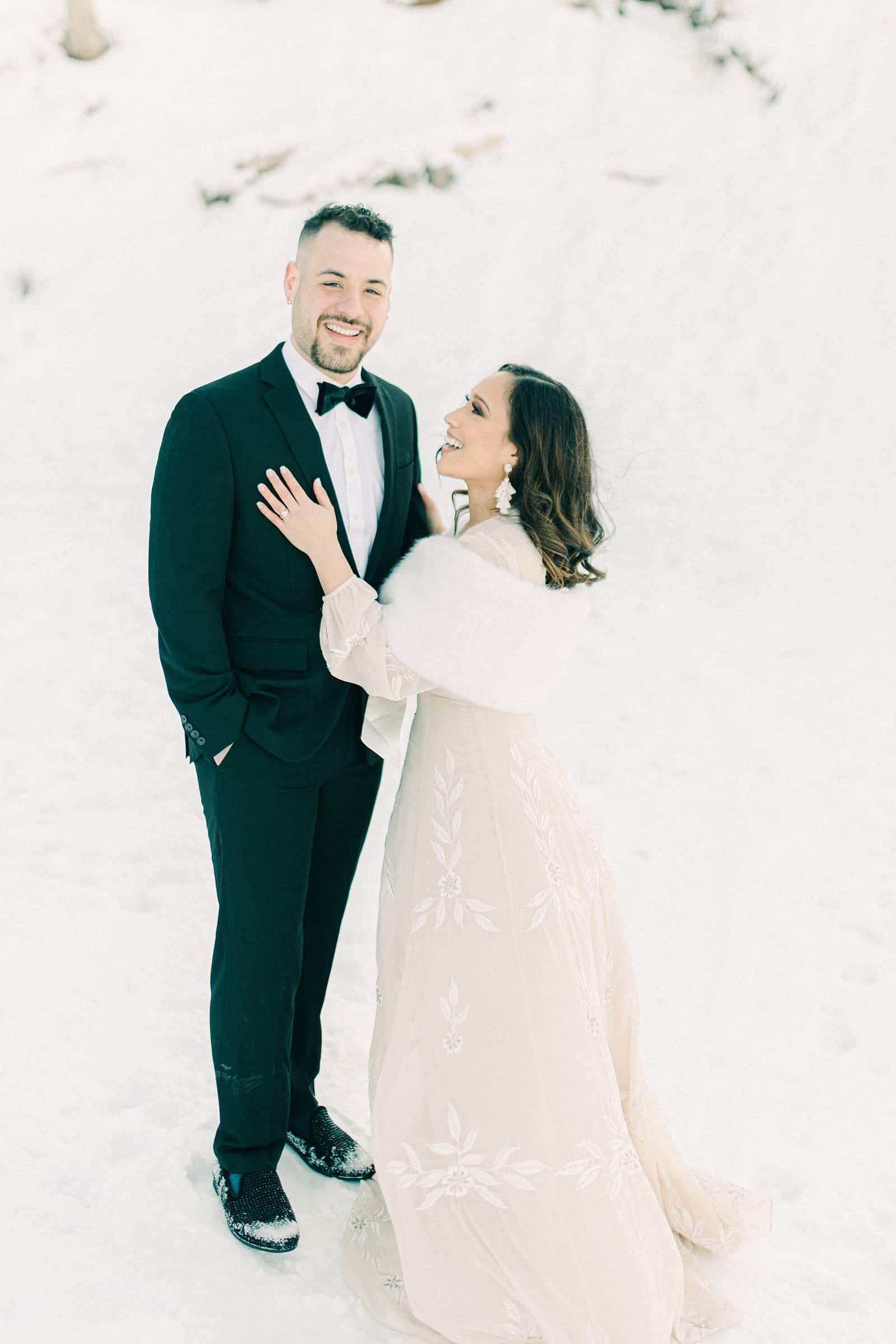 Bride and groom in snowy trees, winter wedding