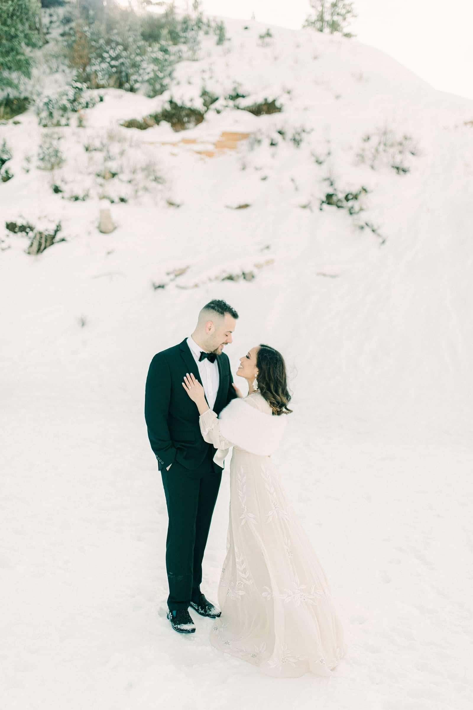 Bride and groom winter wedding, long flowy maxi dress