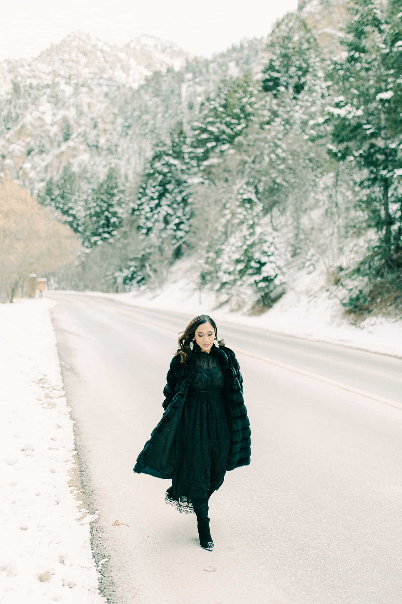 What to wear for winter engagement session, black lace dress and faux fur coat