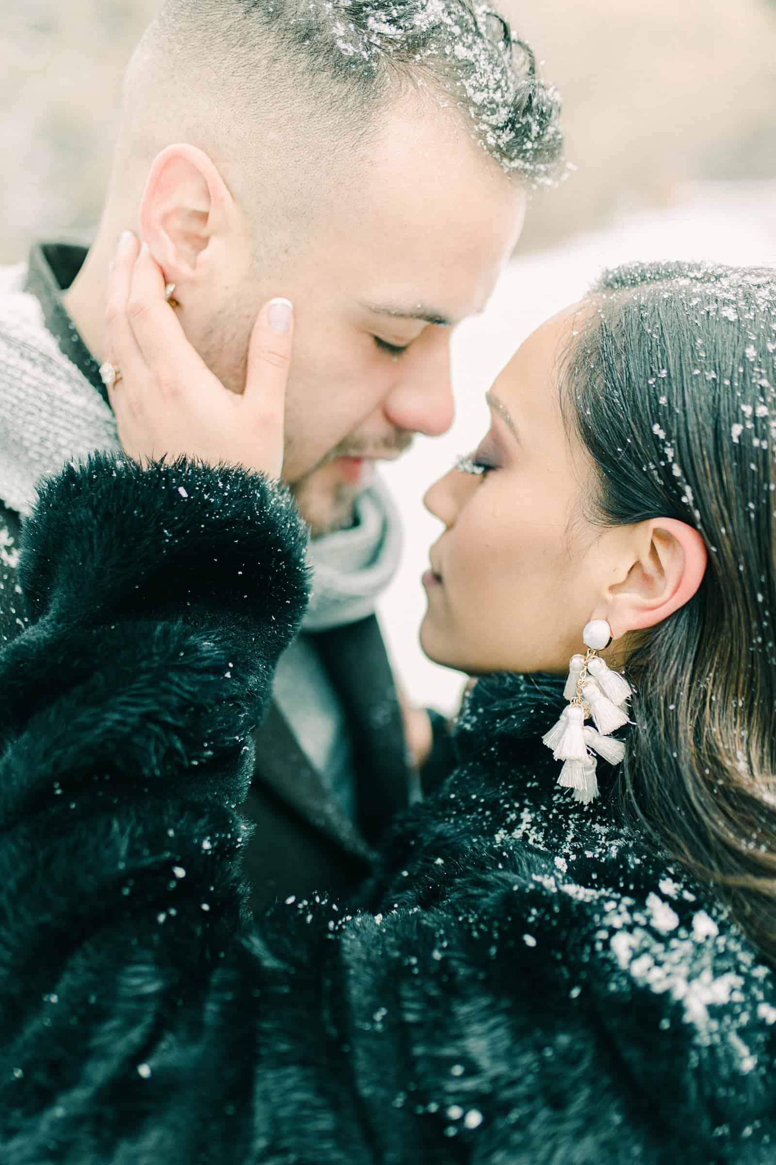 Snow on eyelashes, winter engagement