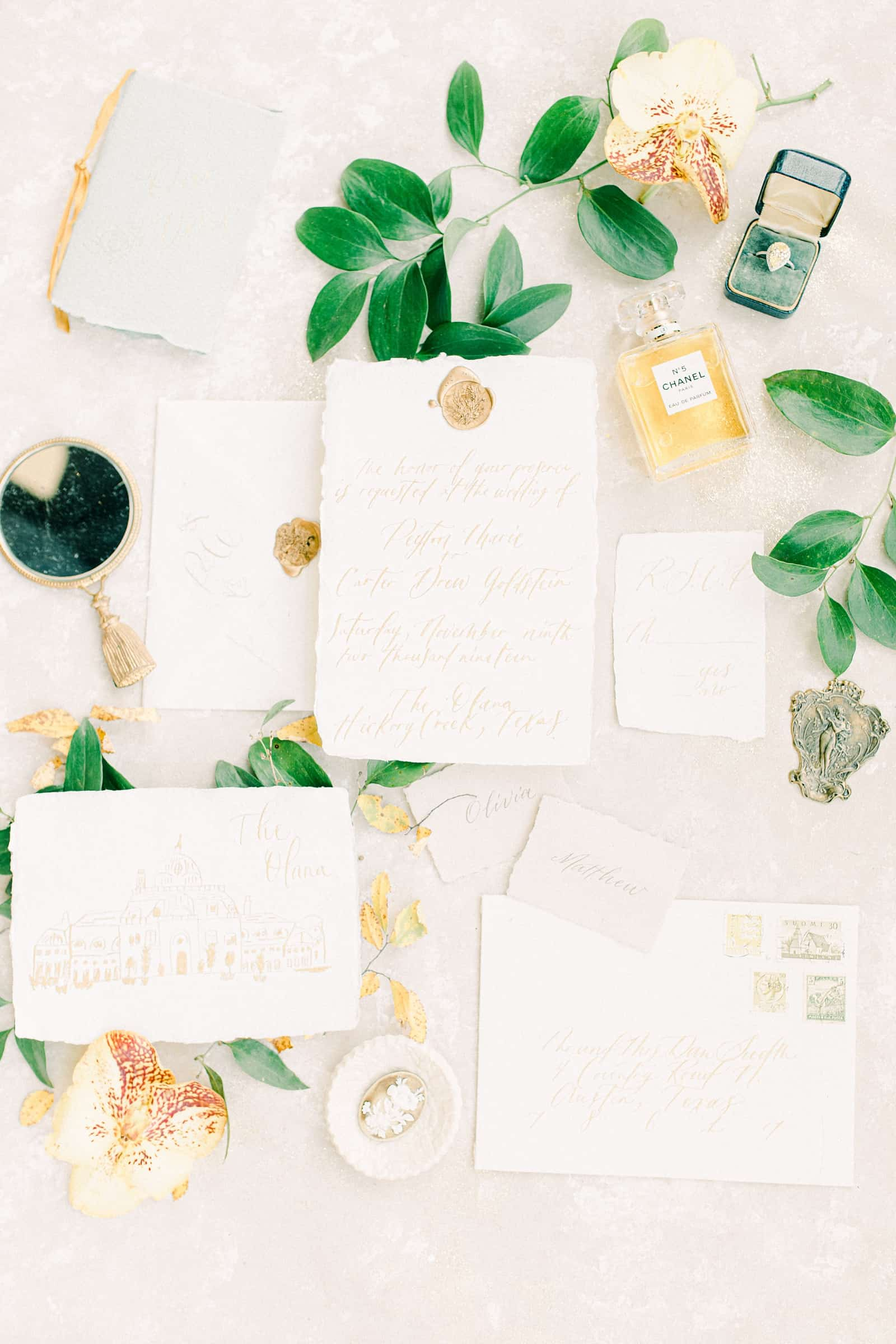 Fine art wedding invitations with calligraphy and gold wax seal