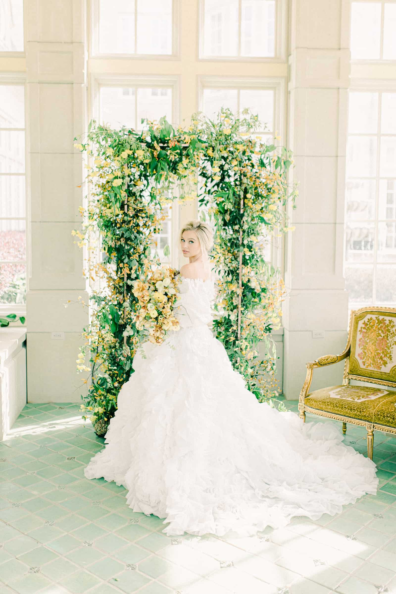 Bride wearing big ball gown with puff sleeves and long train