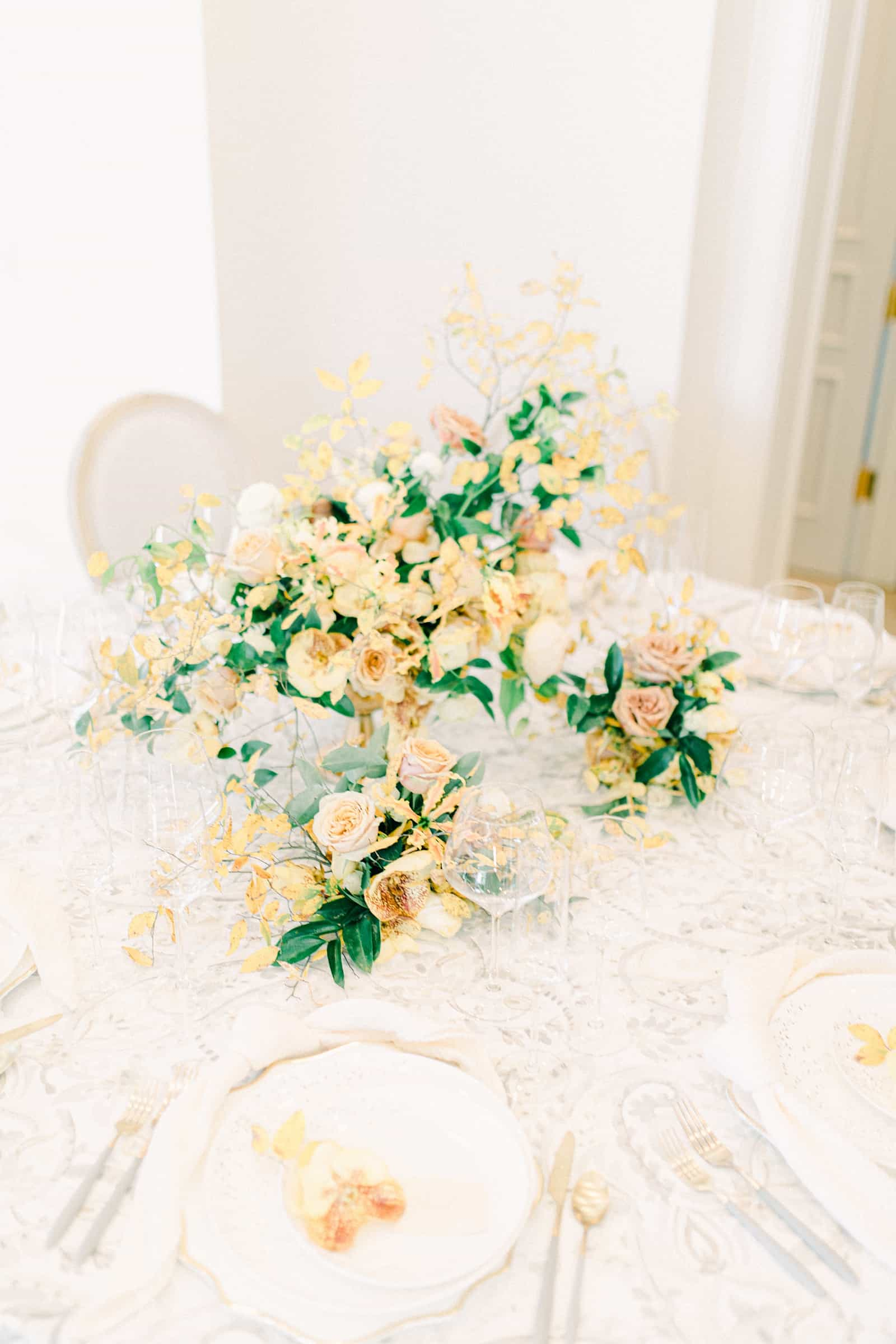 Yellow and white wedding fall centerpiece with orange orchids, secret garden wedding