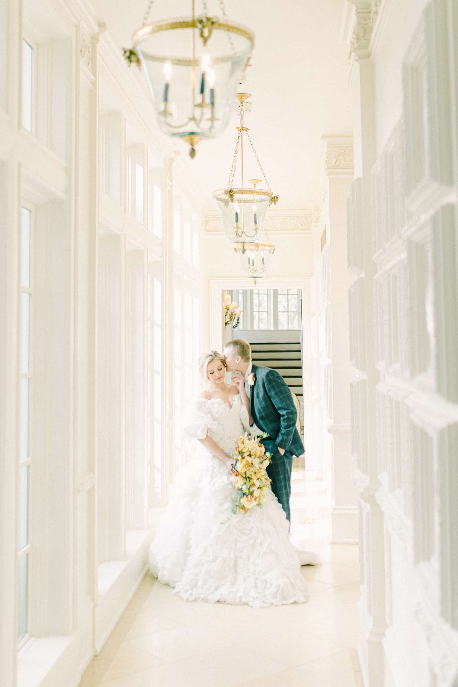 Bride and groom in white hallway , bride and groom poses