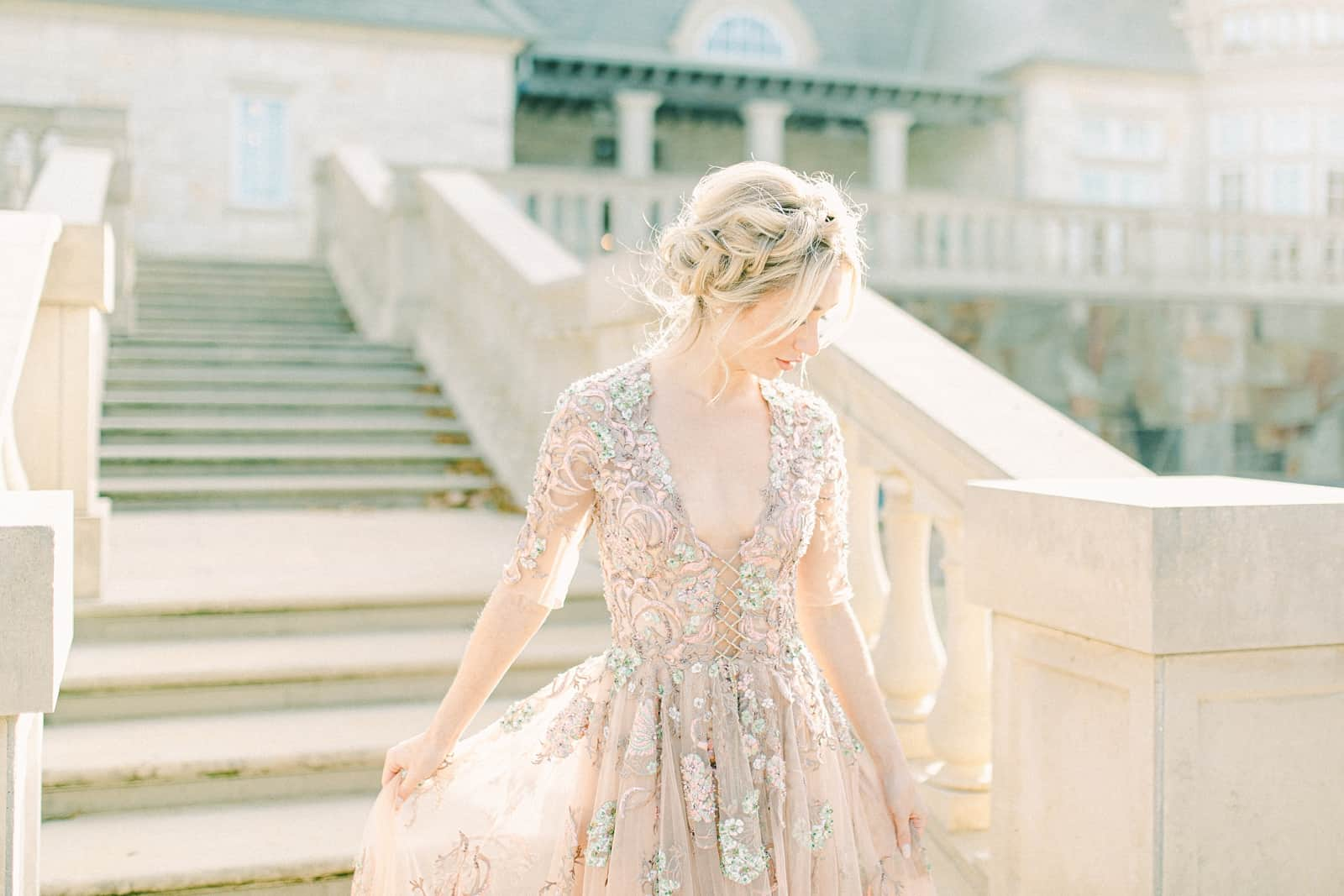 Bride wearing YSA Makino couture wedding dress with floral embellishments and embroidery, flowy wedding dress, European bride