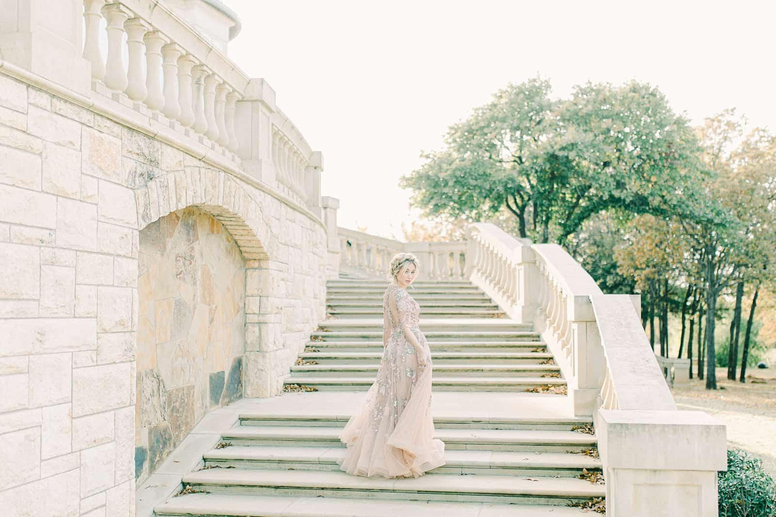 European inspired wedding venue, bride on sweeping marble staircase