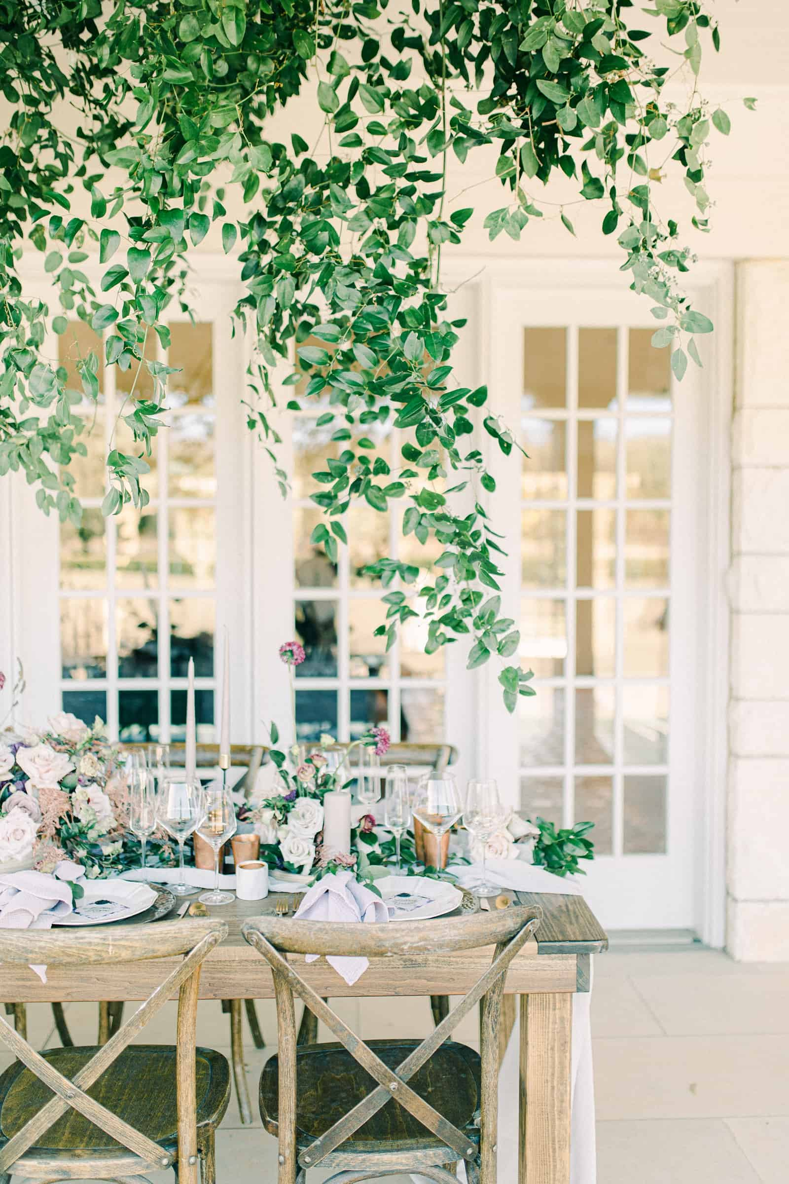 Garden wedding tables cape with greenery canopy