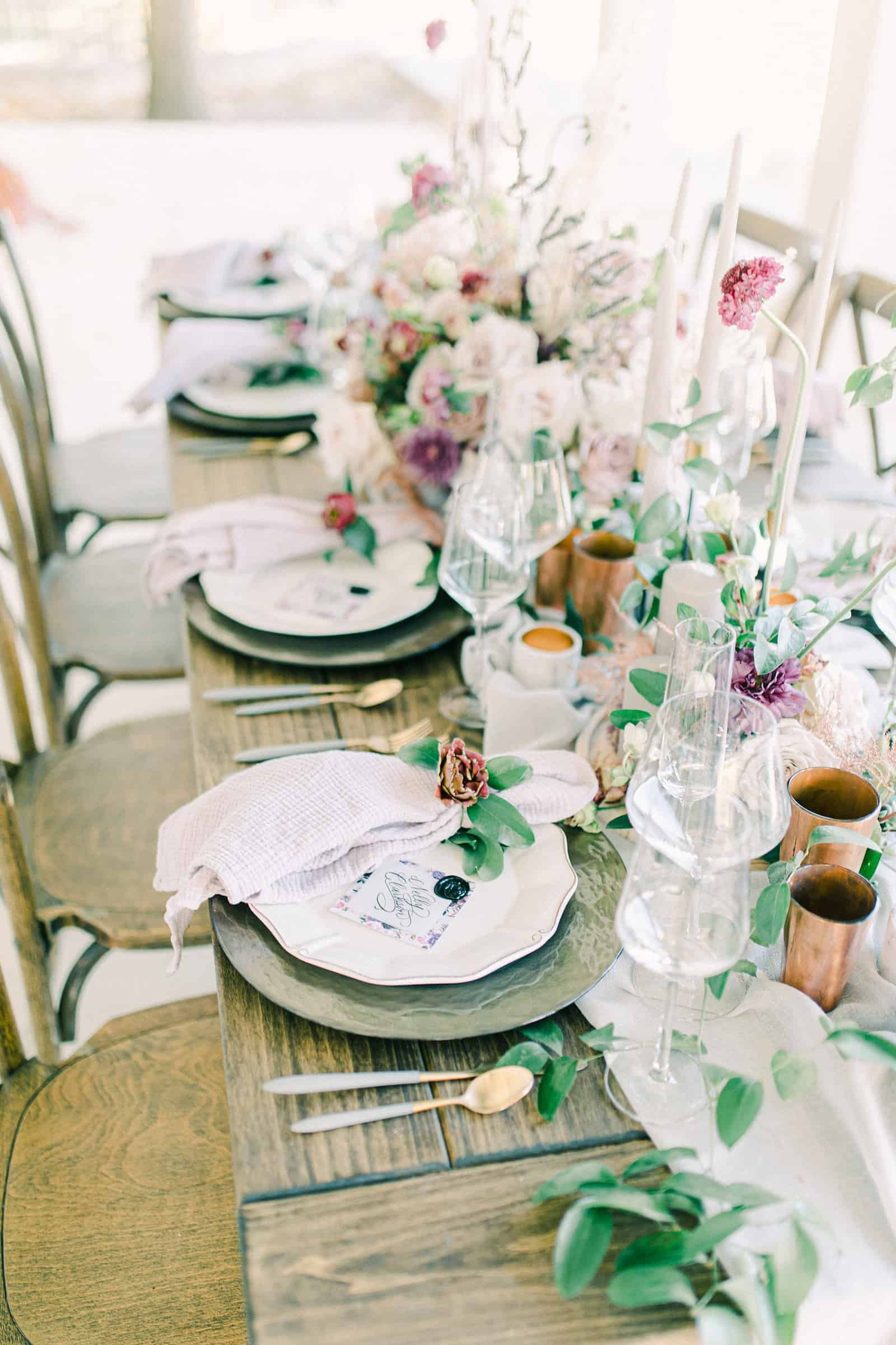 nature inspired wedding table for bridal party with flower napkin rings