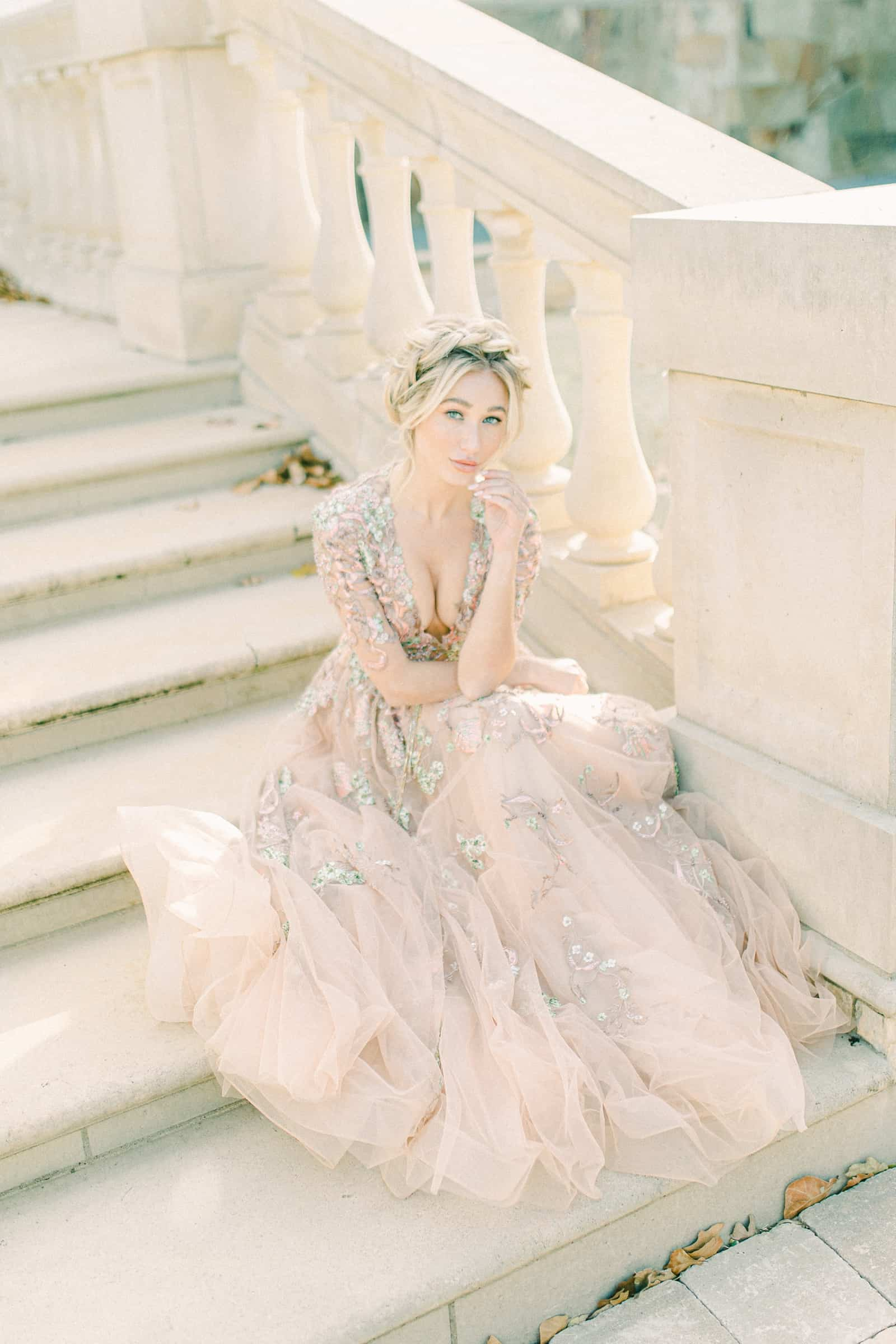 Bride wearing blush wedding dress awith floral embroidery and plunging neckline, YSA Makino couture wedding dress
