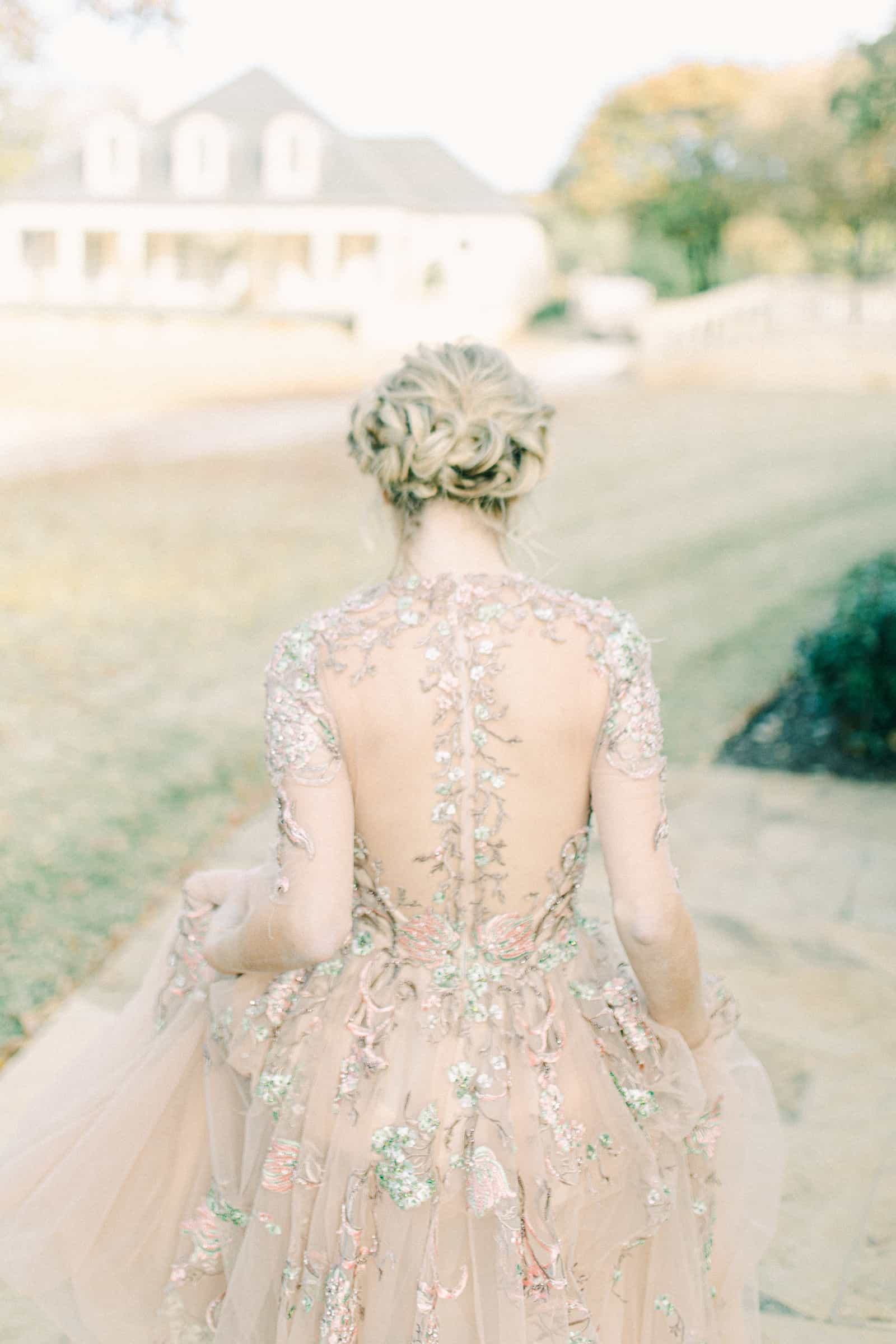 Back button details of couture wedding dress, blush pink gown with floral embroidery and embellishments, unique wedding dress