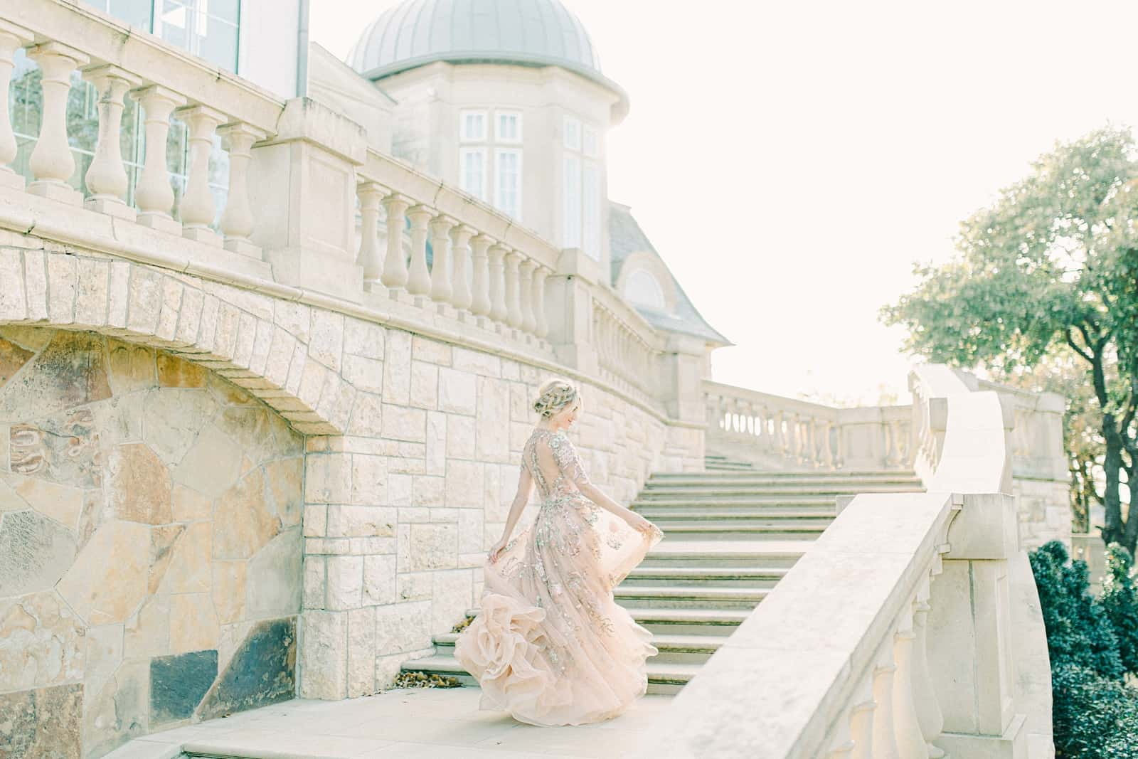Bride twirling on steps of staircase in Rome, Italy