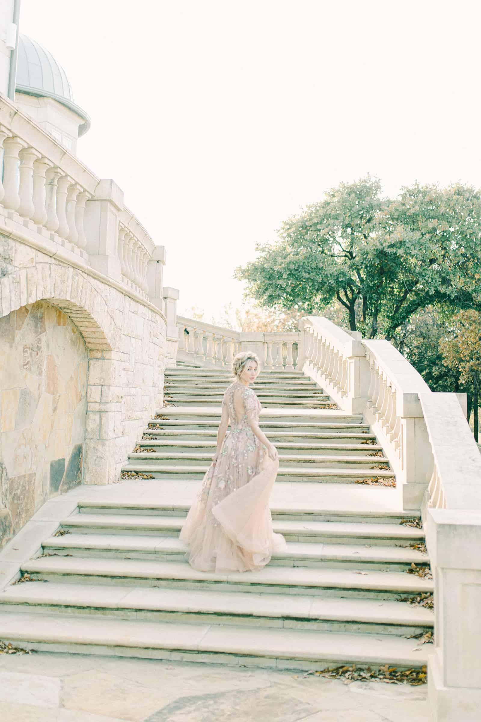 European mansion bride on staircase, destination wedding in Paris