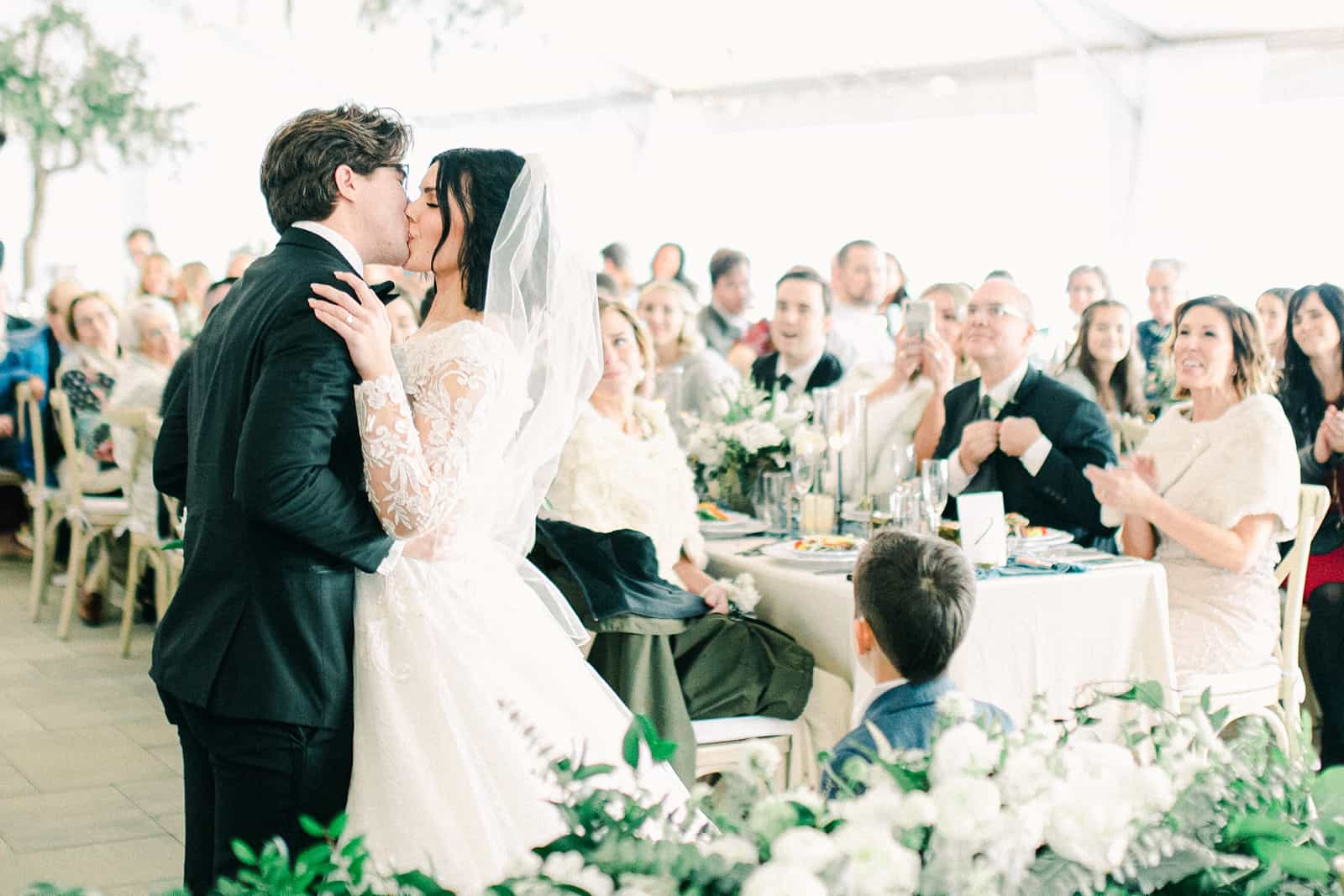 Luxury winter wedding at Willowbridge Estate in Boise, Idaho, bride and groom first kiss after ceremony