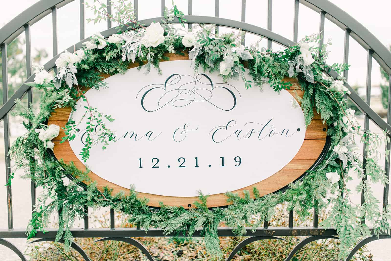 All white winter wedding with calligraphy wedding sign