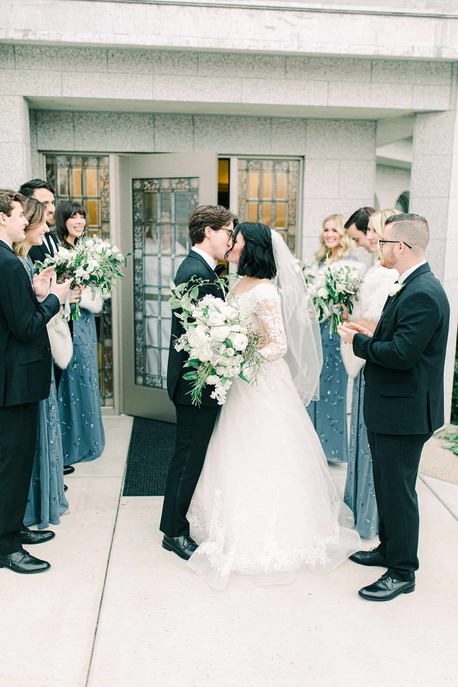 Bride and groom kiss temple wedding exit, Boise LDS Temple