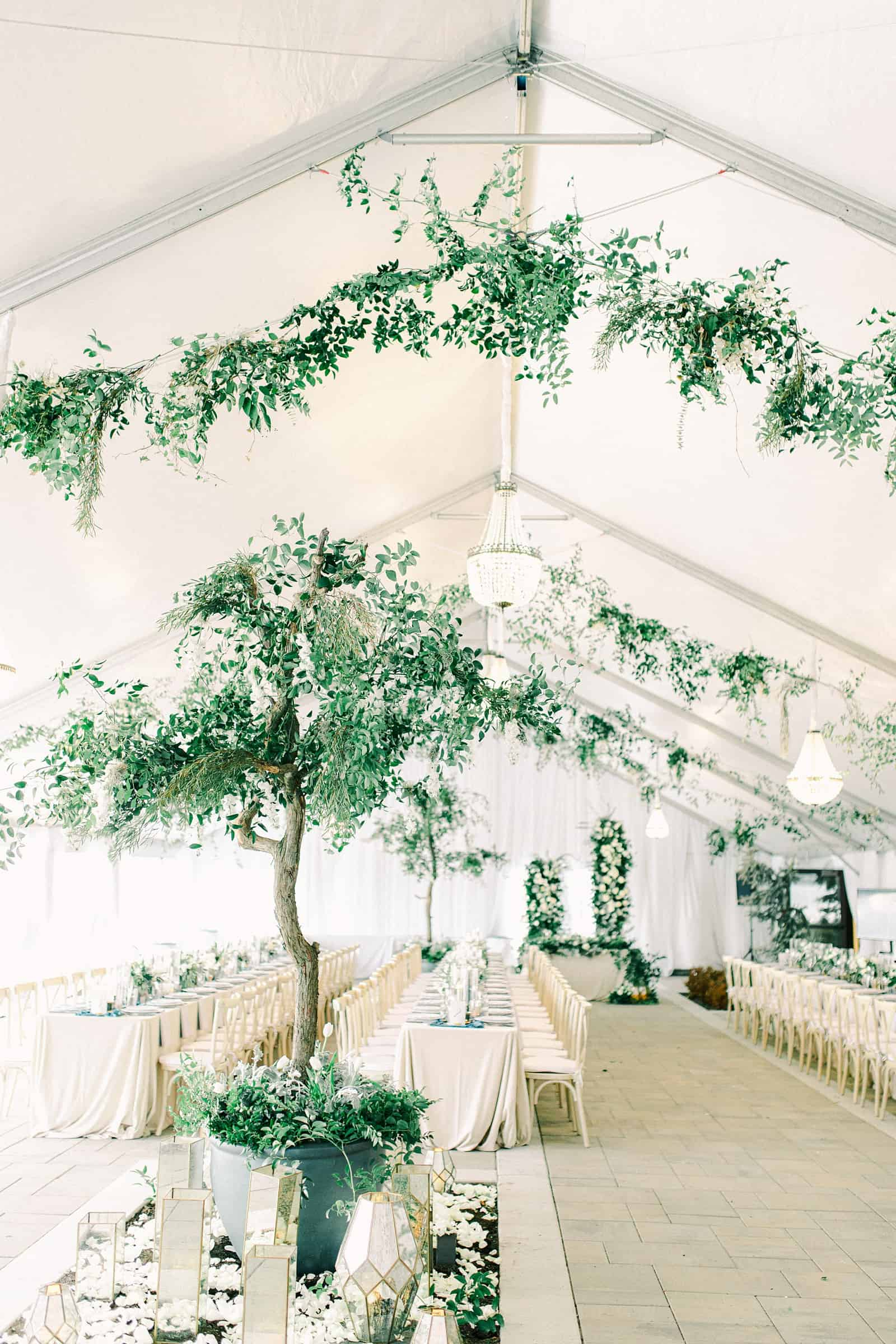 Luxury winter wedding at Willowbridge Estate in Boise, Idaho, white tent reception with greenery tree centerpieces and candles