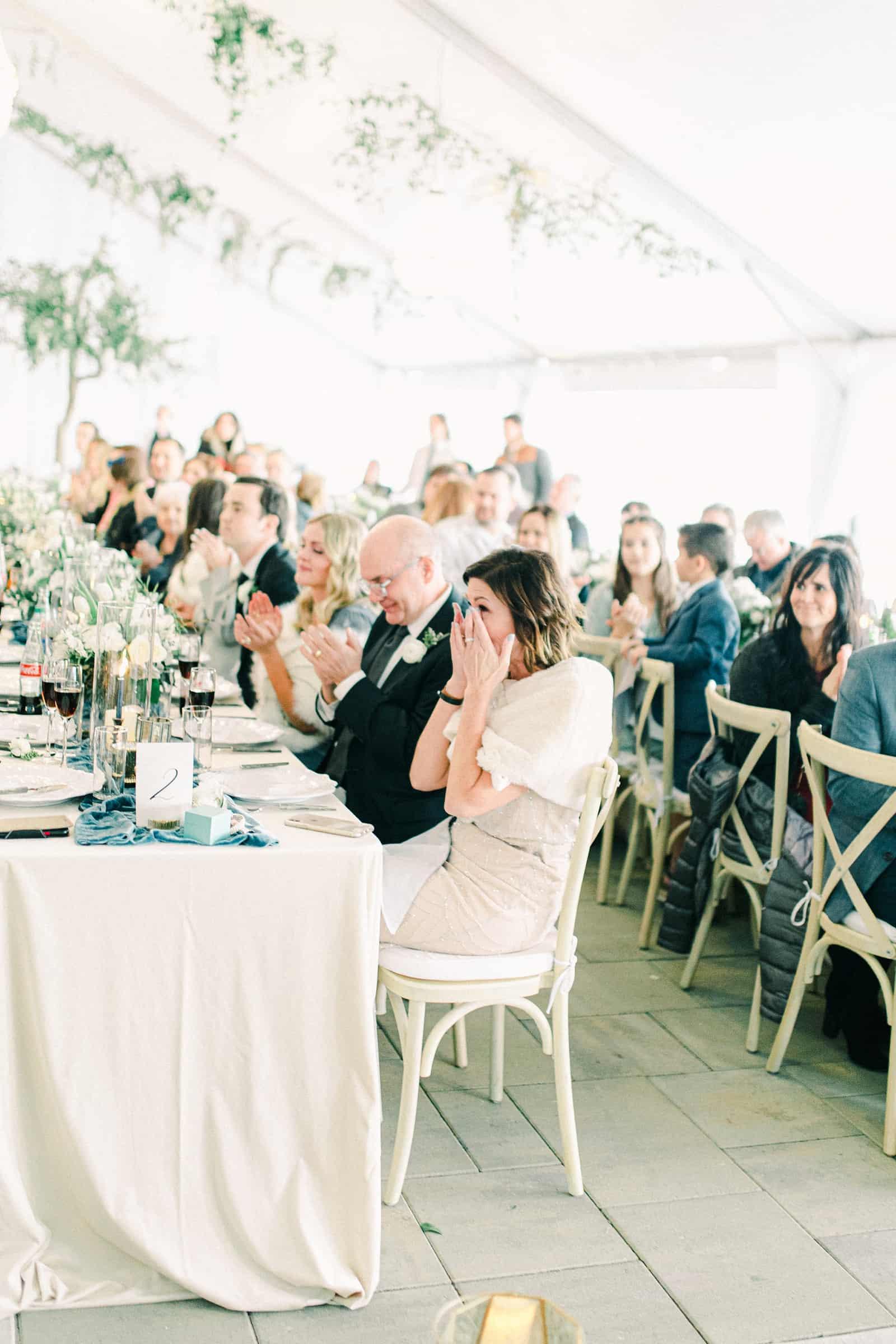 Winter wedding inside white tent reception