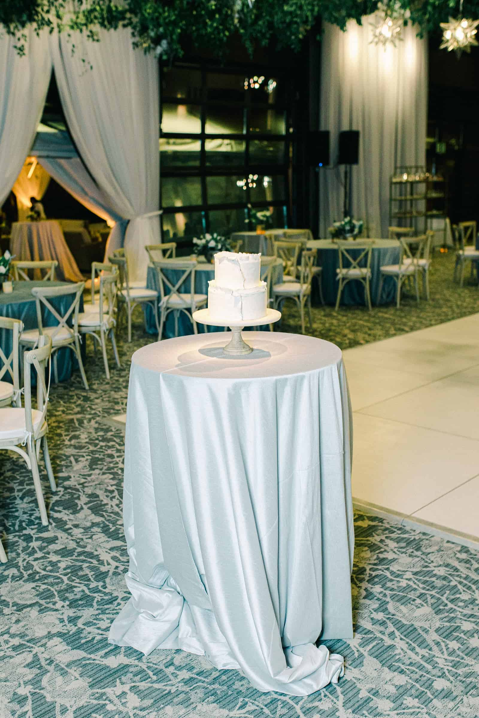 White and gray two tier modern wedding cake, reception decor