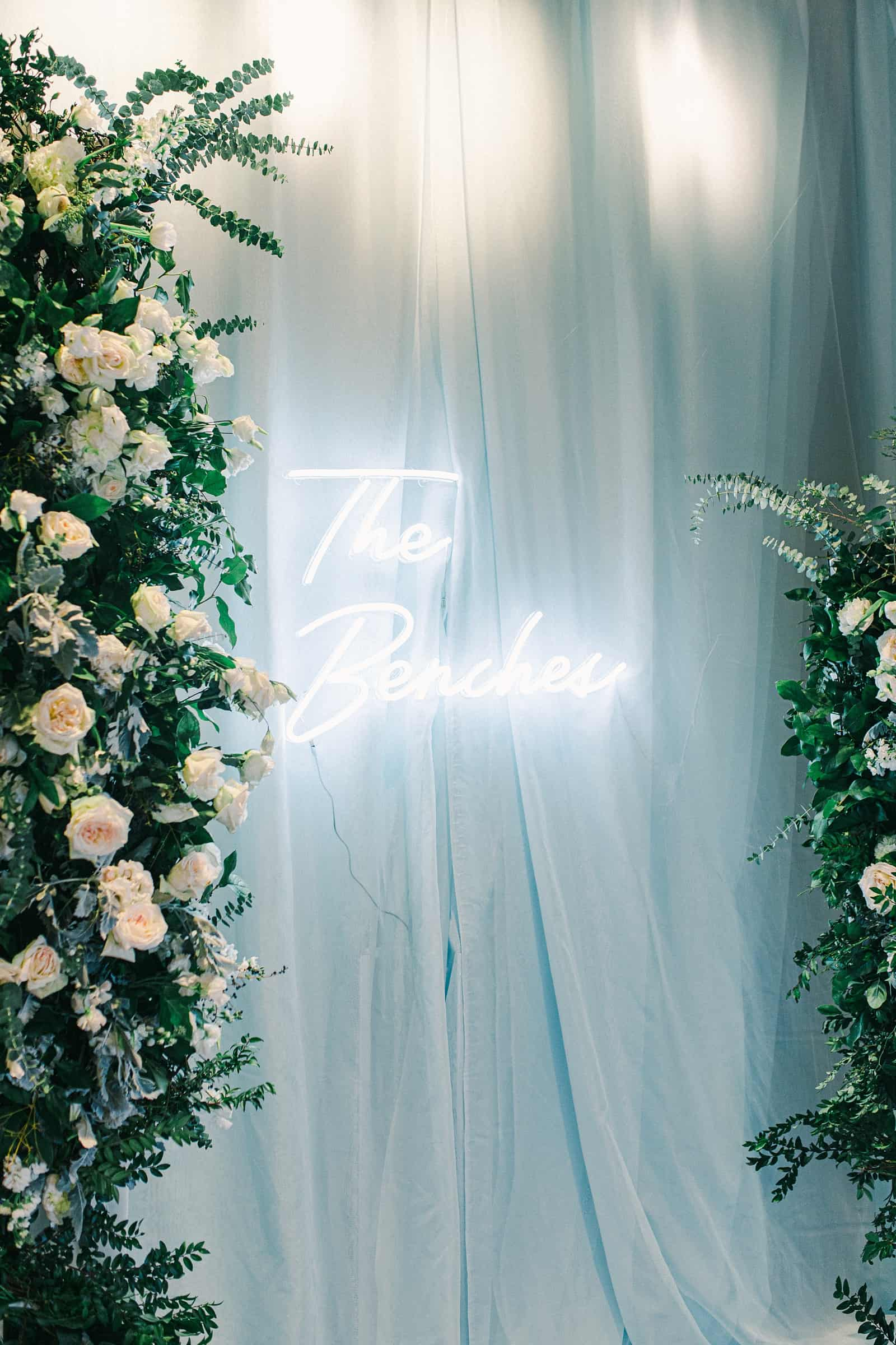 Winter wedding reception decor, custom neon sign with bride and groom name