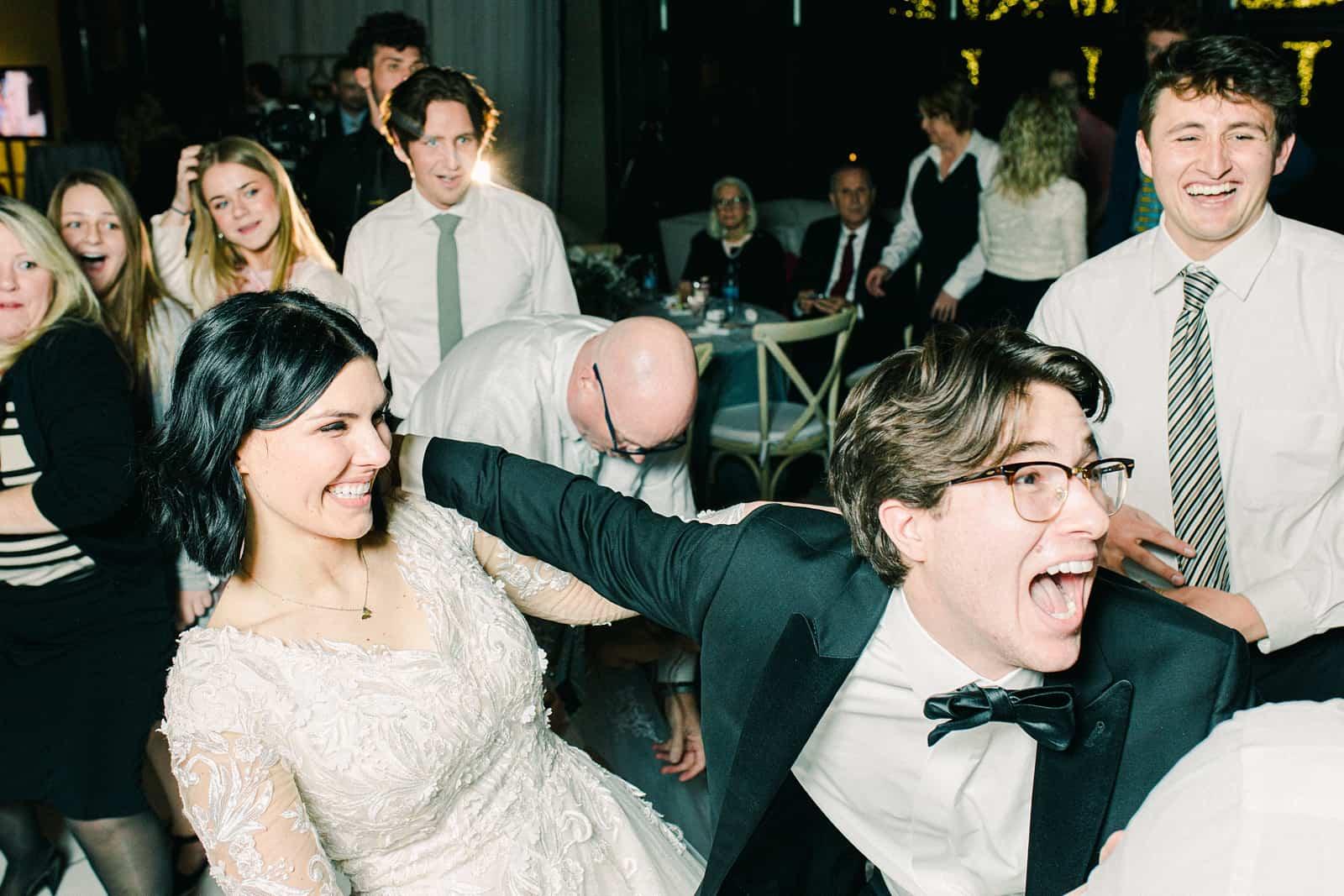 Bride and groom dance winter wedding reception