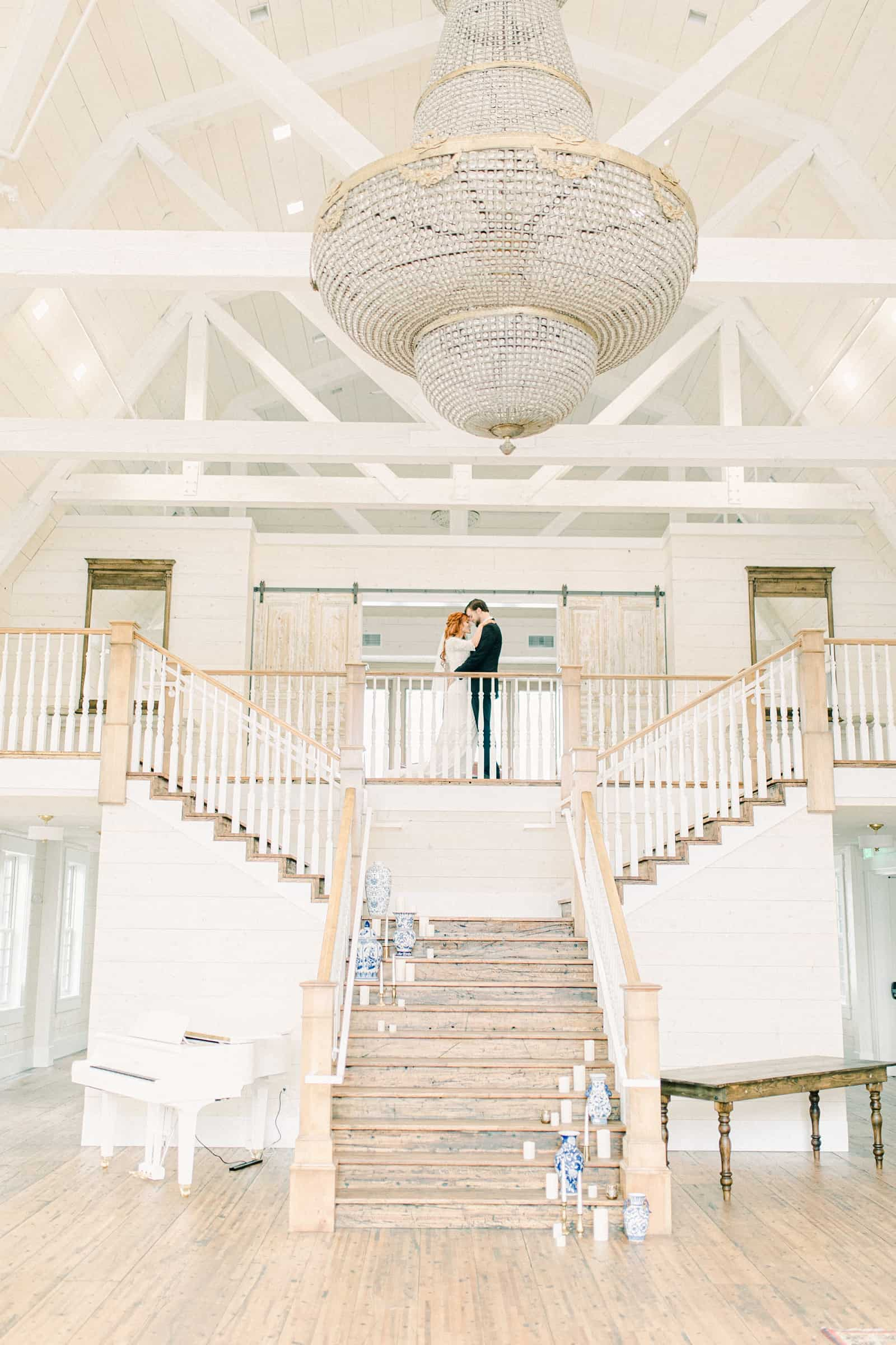 Walker Farms wedding, Utah wedding photography, bride and groom at top of staircase