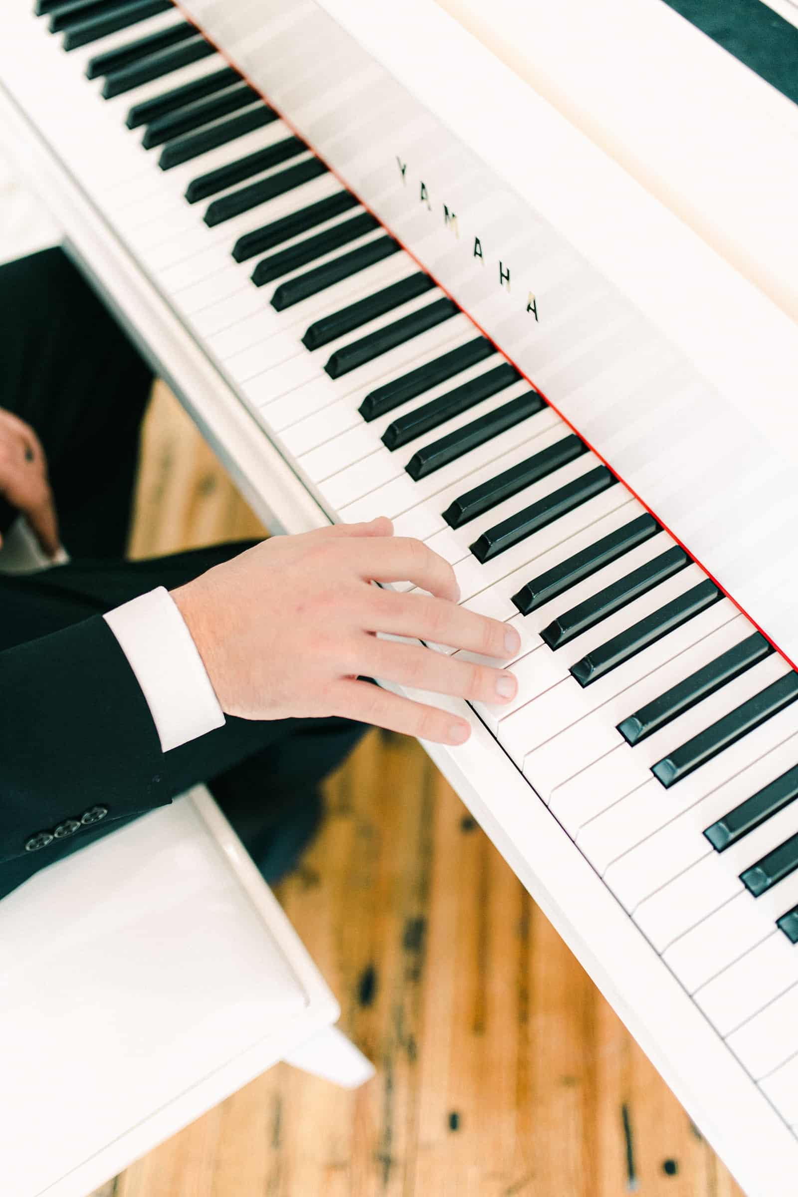 Groom serenades bride at the piano, special wedding song